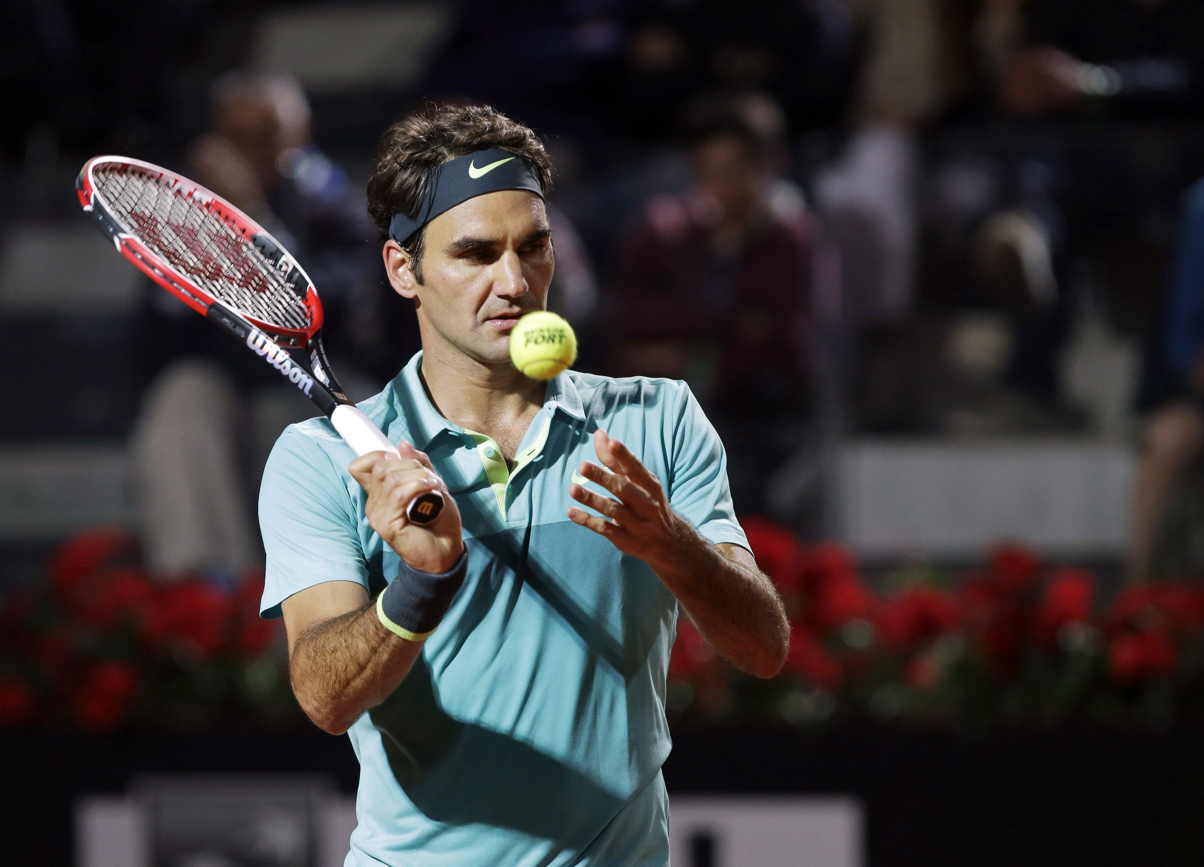 Roger Federer, of Switzerland, prepares to serve the ball to his compatriot Stan Wawrinka during a semifinal match at the Italian Open tennis tournament, in Rome, Saturday, May 16, 2015. Federer beat  Wawrinka 6-4, 6-2. (AP Photo/Alessandra Tarantino)