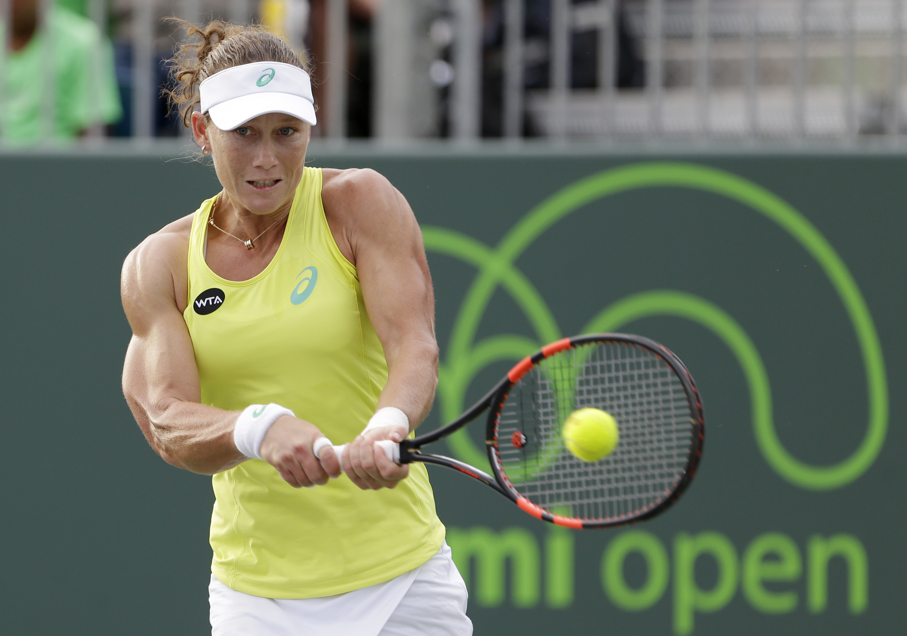 Samantha Stosur, of Australia, returns a shot from Venus Williams at the Miami Open tennis tournament, Saturday, March 28, 2015 in Key Biscayne, Fla. Williams won 6-4, 7-6 (3). (AP Photo/Wilfredo Lee)