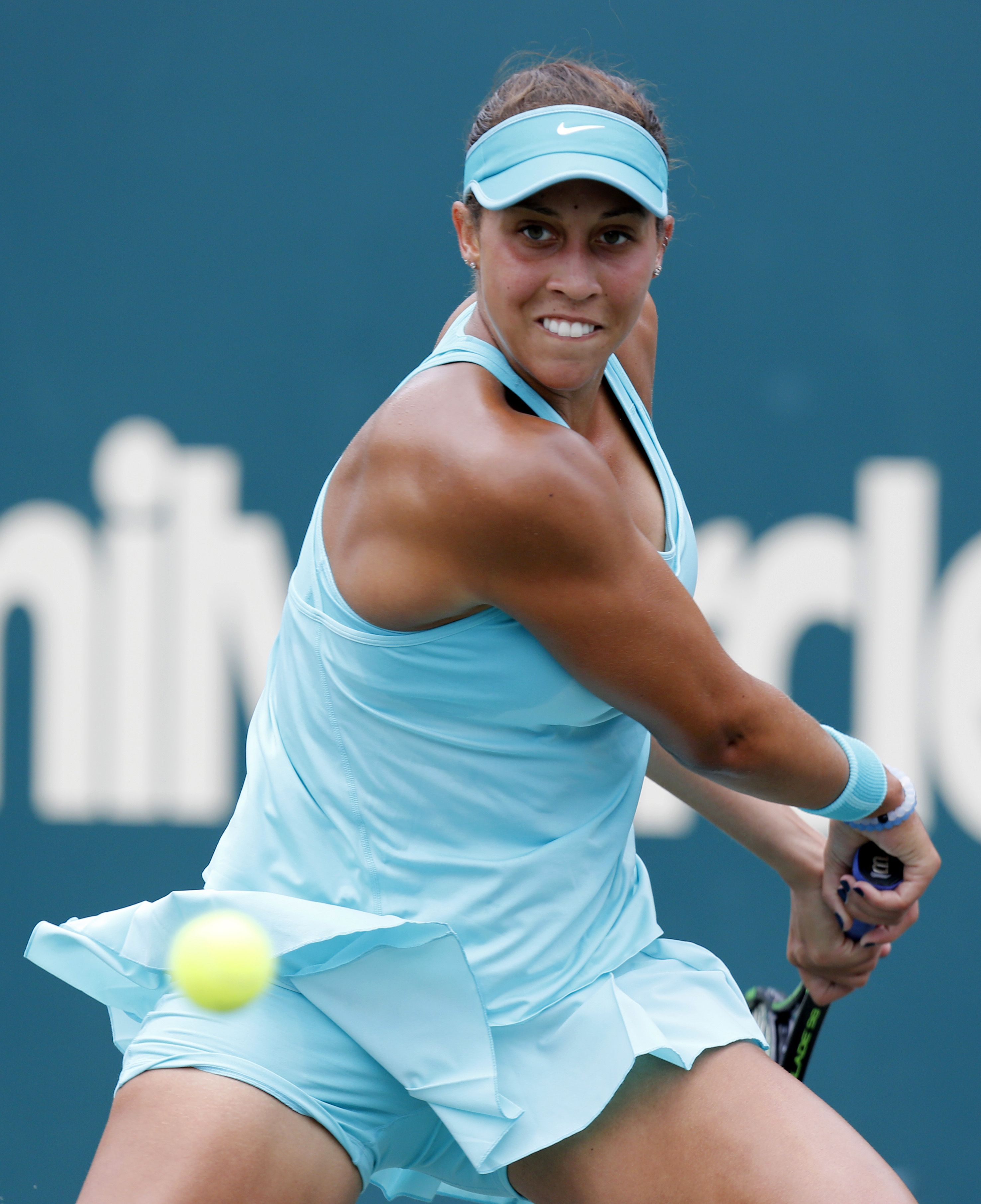 Madison Keys returns a shot against Angelique Kerber during singles final action at the Family Circle Cup tennis tournament in Charleston, S.C., Sunday, April 12, 2015. Kerber won the Family Circle Cup by beating Keys 6-2, 4-6, 7-5. (AP Photo/Mic Smith)