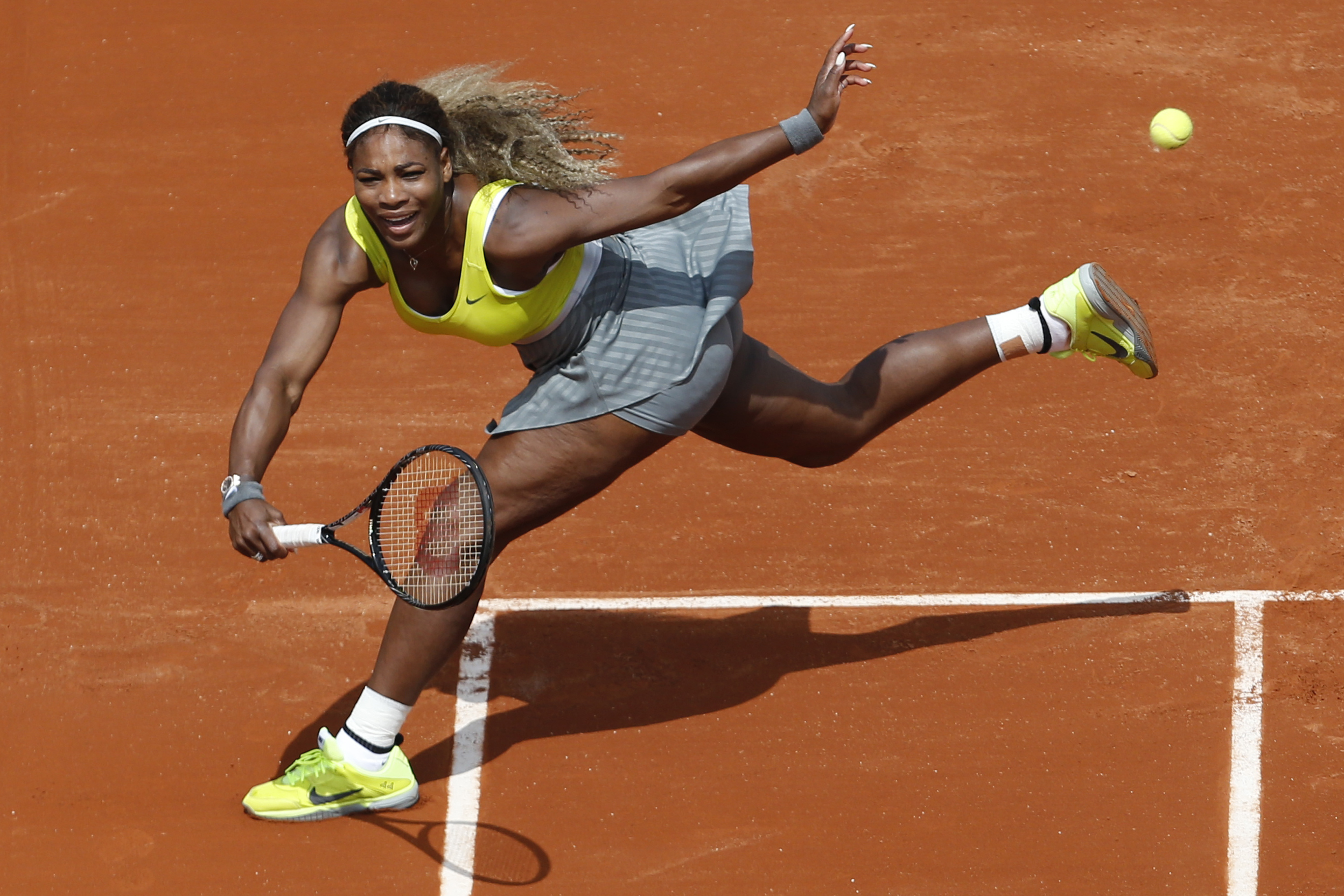 FILE - In this May 25, 2014, file photo, Serena Williams makes a return against Alize Lim, of France, during a first round match at the French Open tennis tournament in Paris, France. Serena Williams will be competing in the 2015 French Open tennis tourna