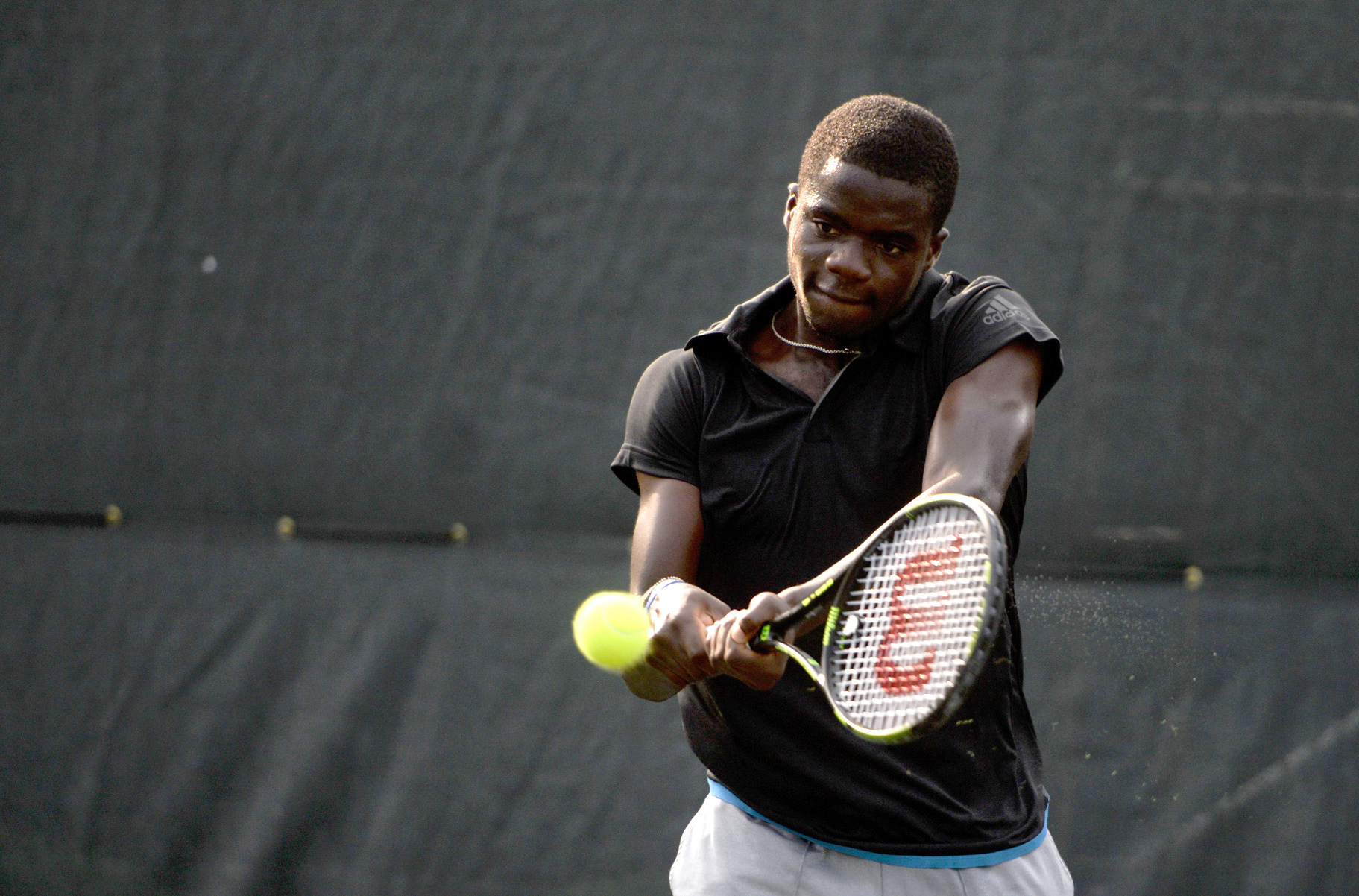 FILE - In this April 25, 2015, file photo, Frances Tiafoe, of the United States, returns a serve from James McGee, of Ireland, during the semifinals of the St. Joseph's/Candler Savannah Challenger tennis tournament in Savannah, Ga.  Tiafoe is among a new