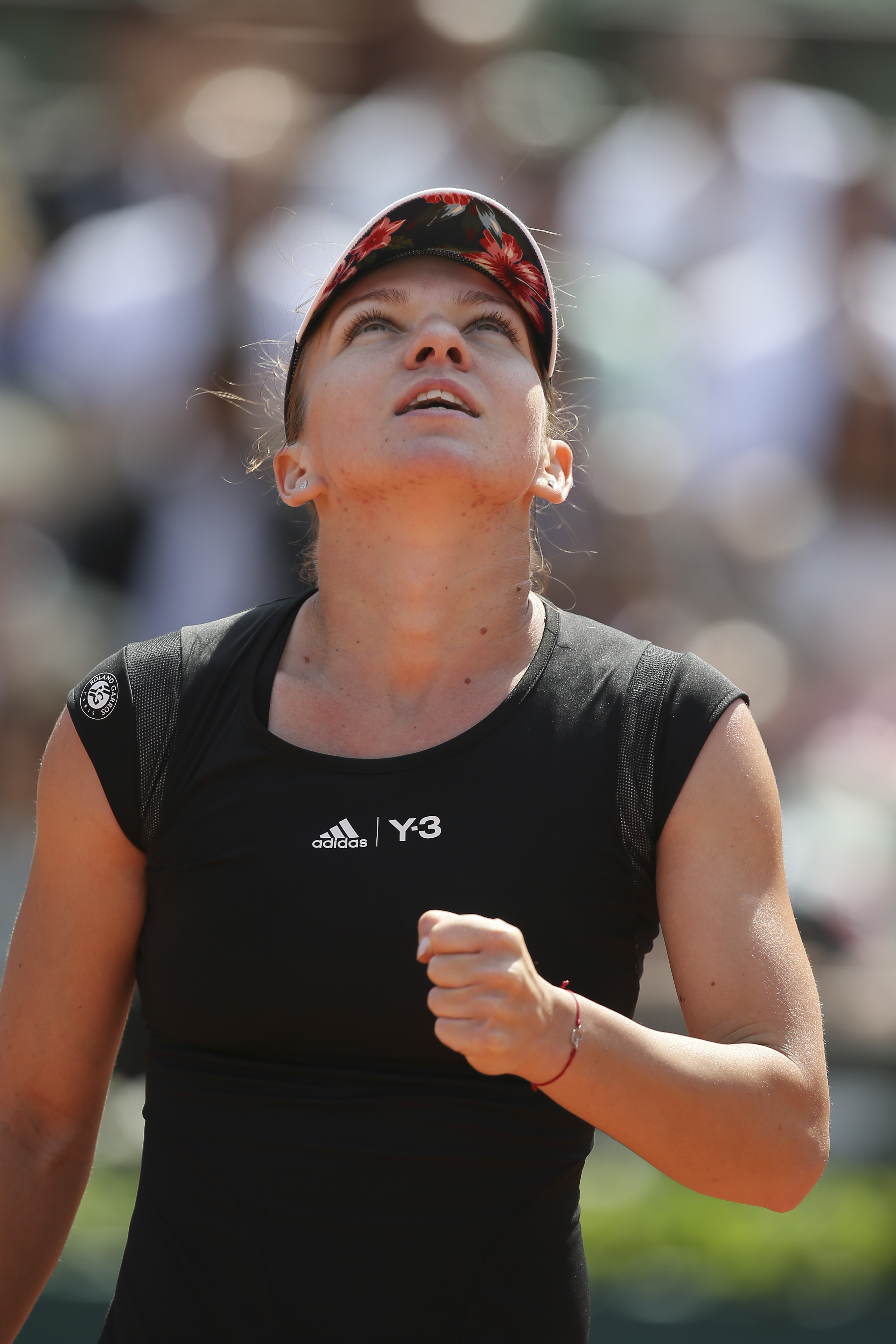 Romania's Simona Halep celebrates in the first round match of the French Open tennis tournament against Evgeniya Rodina of Russia at the Roland Garros stadium, in Paris, France, Sunday, May 24, 2015. Halep won in two sets 7-6, 6-4. (AP Photo/David Vincent
