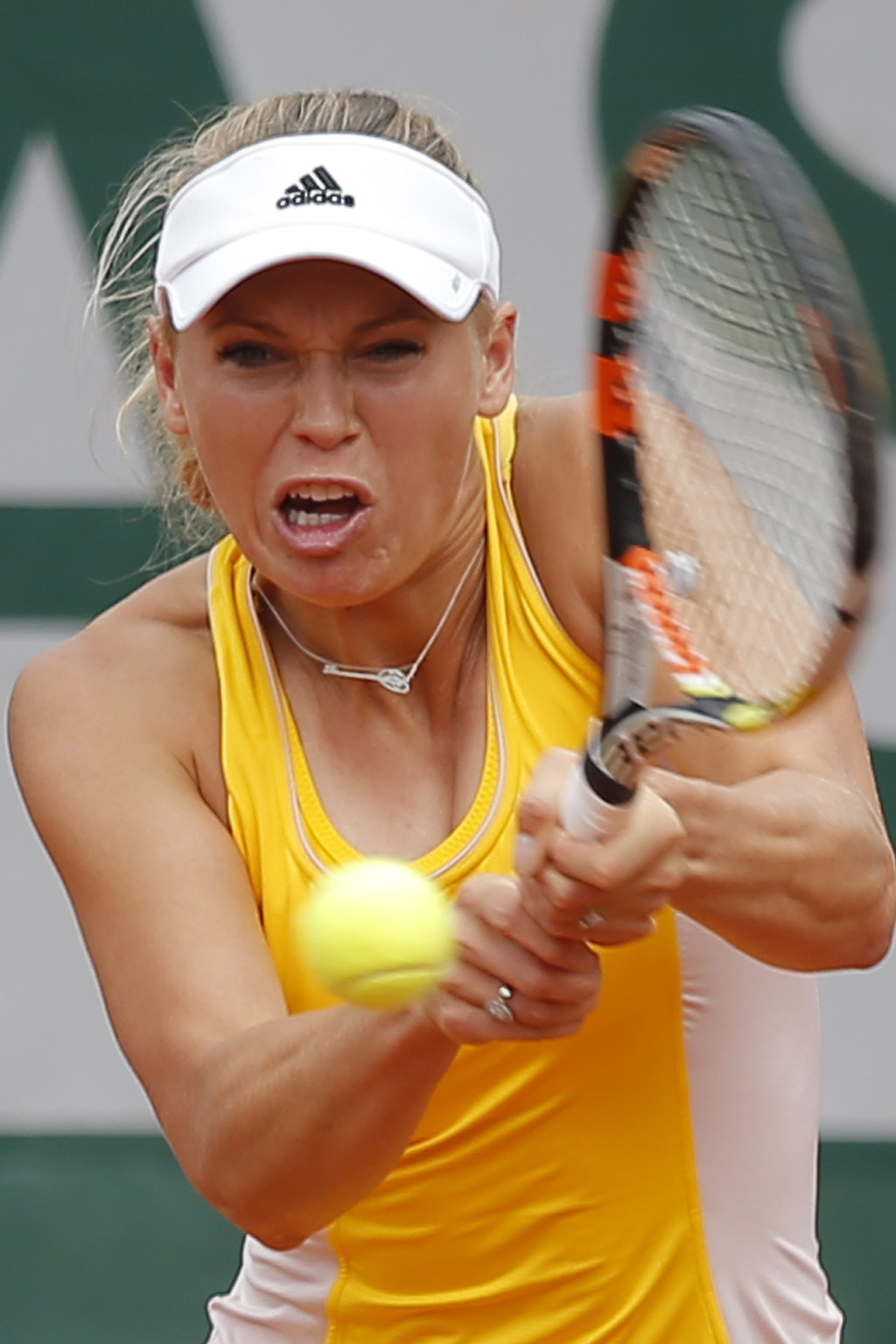 Denmark's Caroline Wozniacki returns in the first round match of the French Open tennis tournament against Italy's Karin Knapp at the Roland Garros stadium, in Paris, France, Tuesday, May 26, 2015. (AP Photo/Francois Mori)