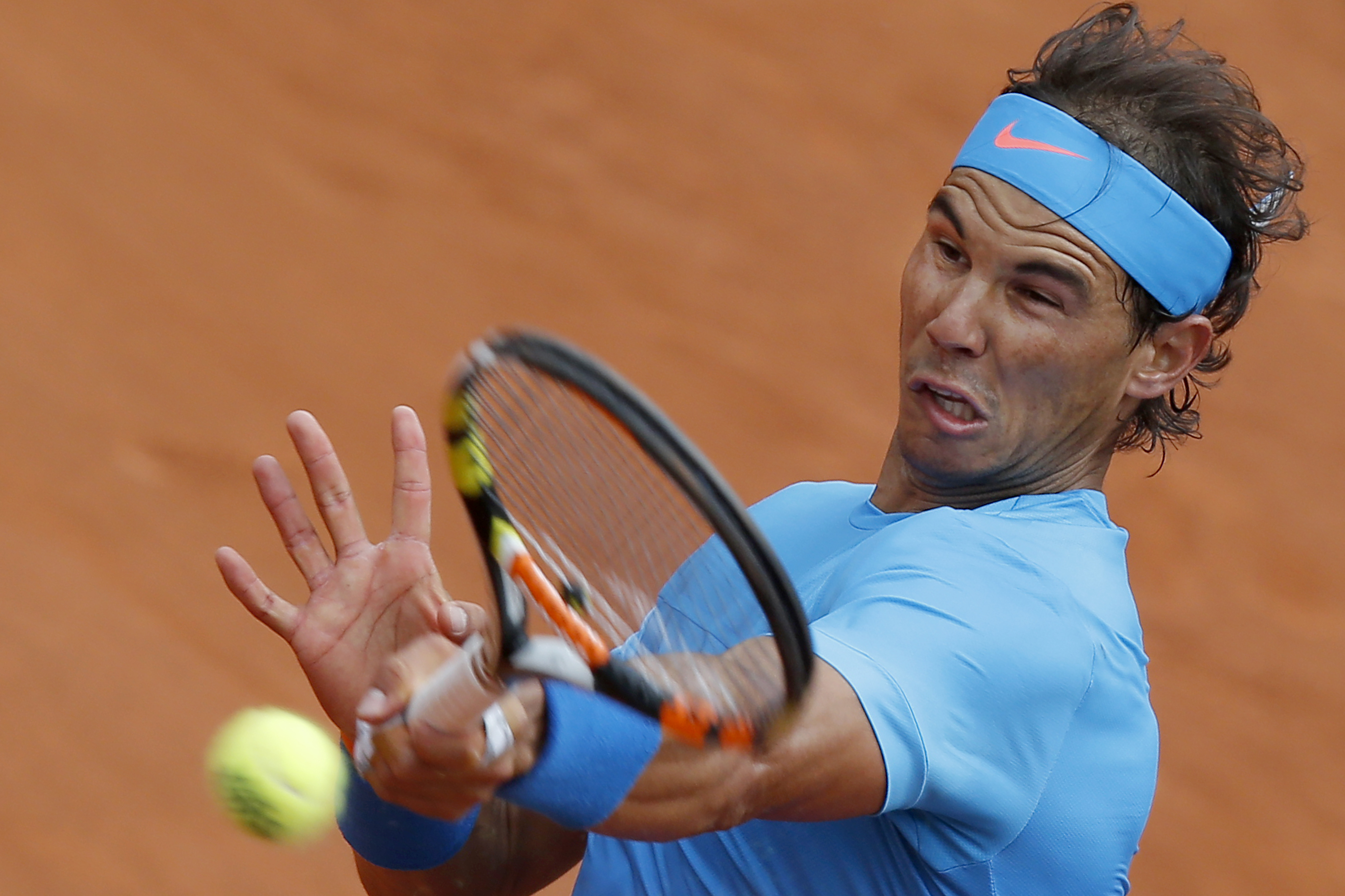 Spain's Rafael Nadal returns in the first round match of the French Open tennis tournament against Quentin Halys of France at the Roland Garros stadium, in Paris, France, Tuesday, May 26, 2015. Nadal won in three sets 6-3, 6-3, 6-4. (AP Photo/Michel Euler