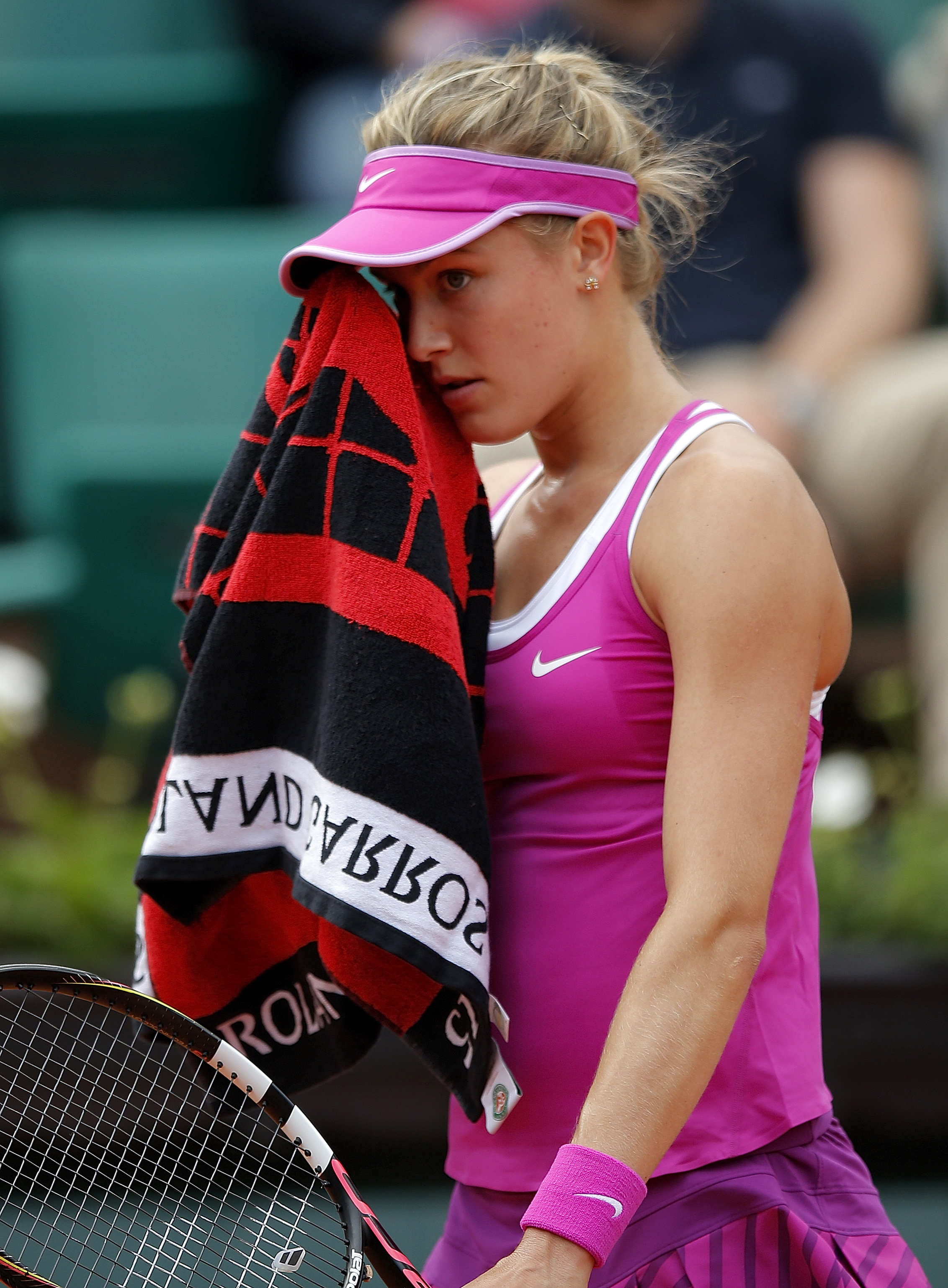 CAPTION CORRECTION, CORRECTS FINAL SCORE IN SECOND SENTENCE - Canada's Eugenie Bouchard wipes her face as she plays France's Kristina Mladenovic during their first round match of the French Open tennis tournament at the Roland Garros stadium, Tuesday, May
