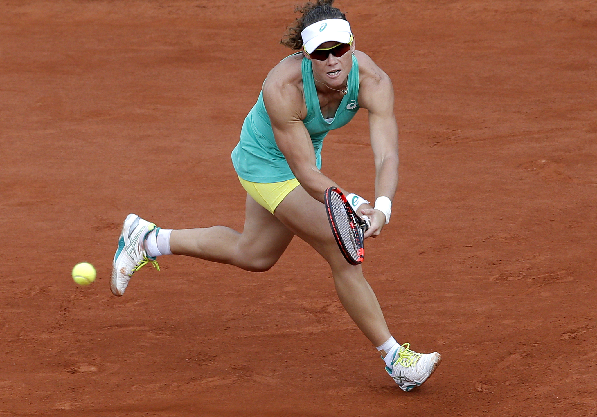 Australia's Samantha Stosur returns the ball to France's Amandine Hesse during their second round match of the French Open tennis tournament at the Roland Garros stadium, Wednesday, May, 27, 2015 in Paris.(AP Photo/Christophe Ena)