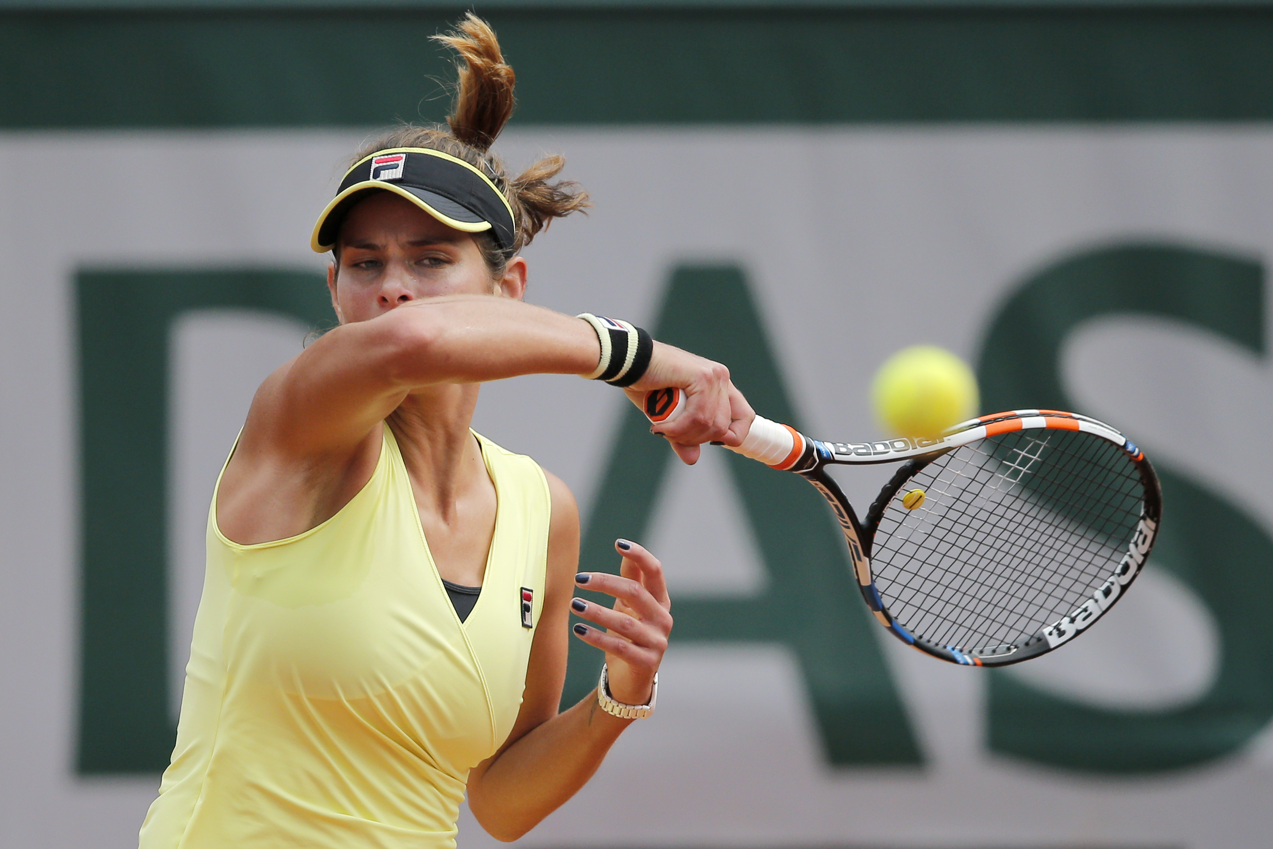Germany's Julia Georges returns in the second round match of the French Open tennis tournament against Denmark's Caroline Wozniacki at the Roland Garros stadium, in Paris, France, Thursday, May 28, 2015. (AP Photo/Christophe Ena)