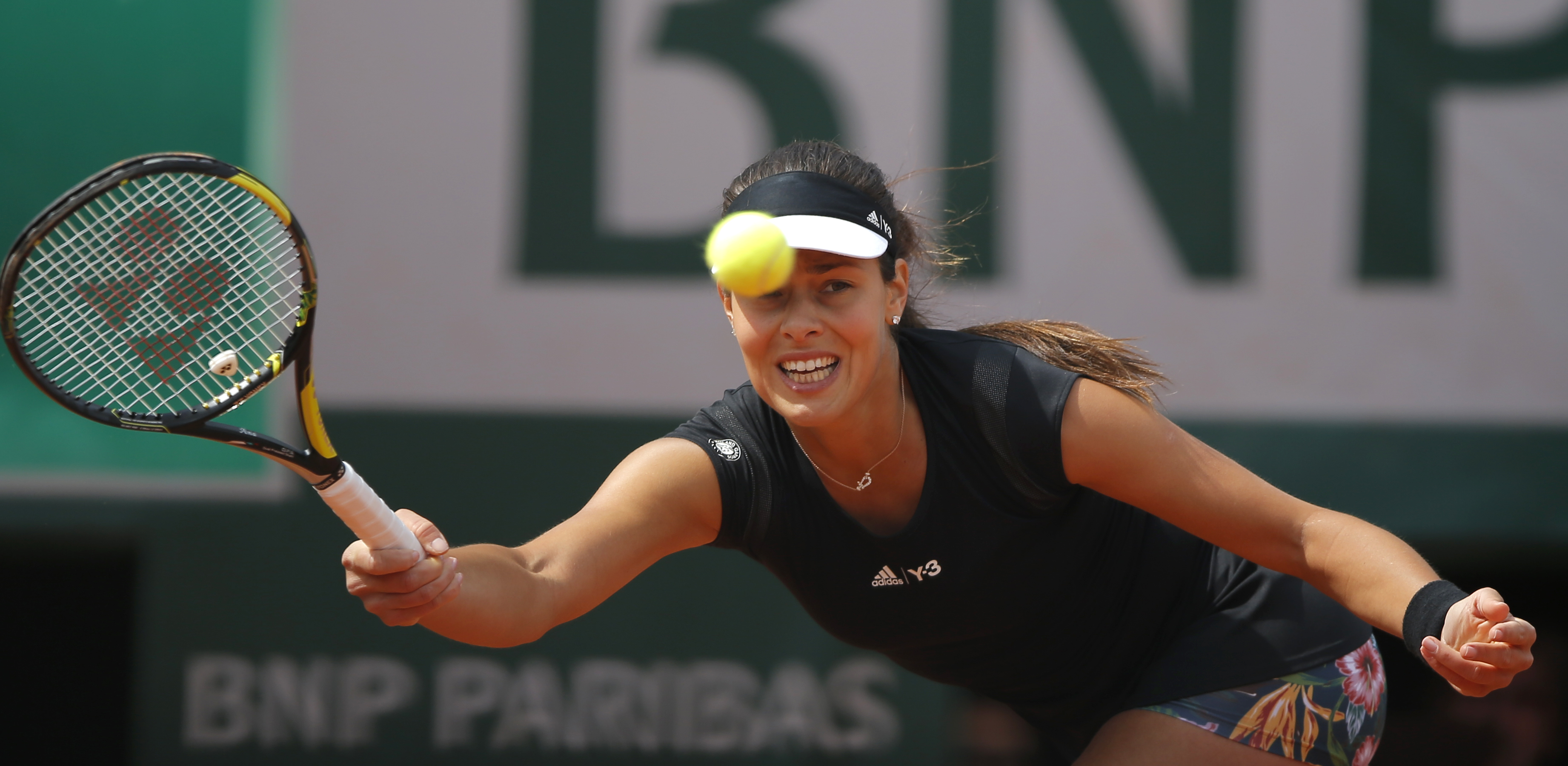 Serbia's Ana Ivanovic returns the ball to Croatia's Donna Vekic during their third round match of the French Open tennis tournament at the Roland Garros stadium, Friday, May 29, 2015 in Paris. Ivanovic won 6-0, 6-3.  (AP Photo/Francois Mori)