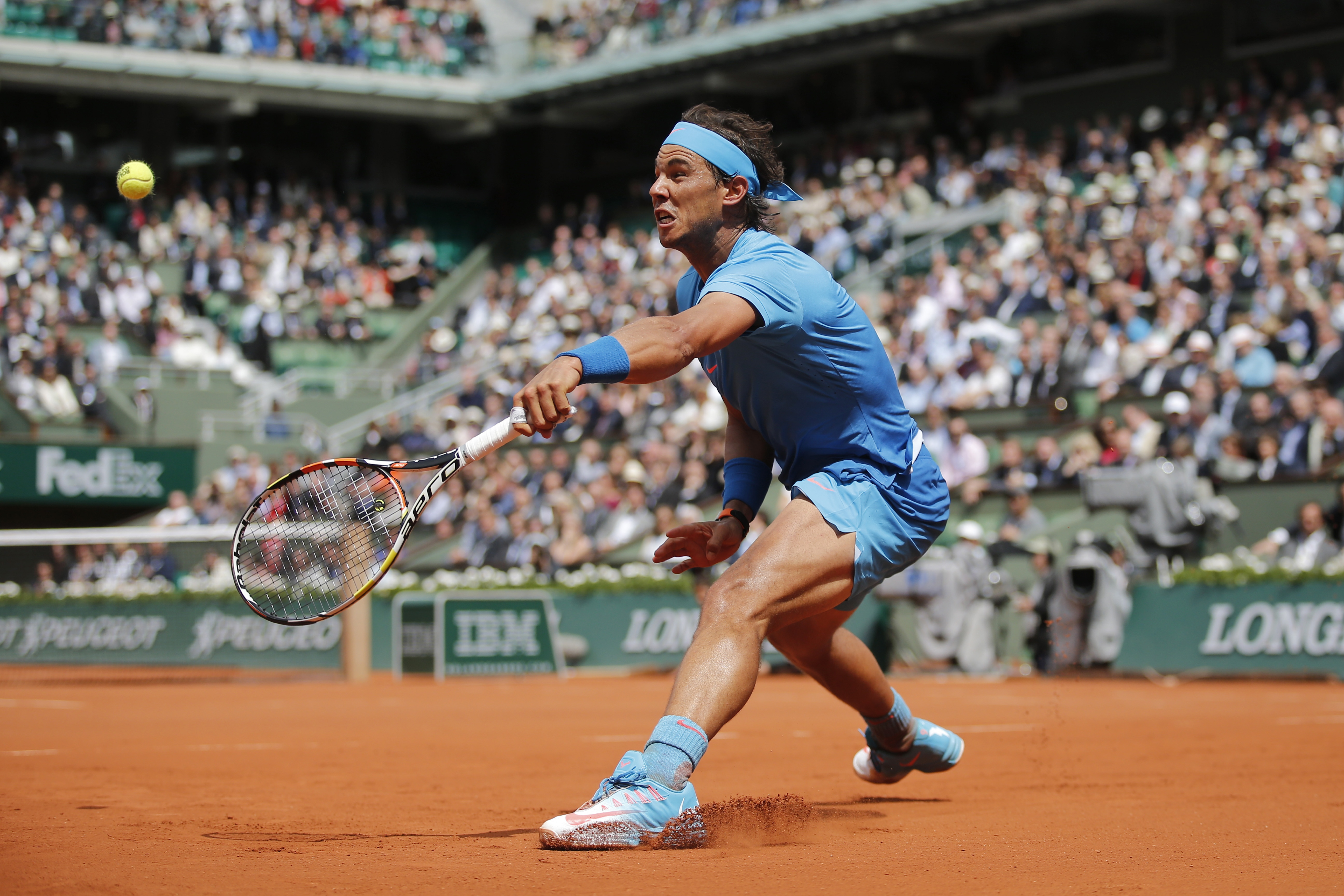 FILE - In this Thursday, May 28, 2015 filer, Spain's Rafael Nadal returns in the second round match of the French Open tennis tournament against Spain's Nicolas Almagro at the Roland Garros stadium, in Paris, France. (AP Photo/Christophe Ena, File)