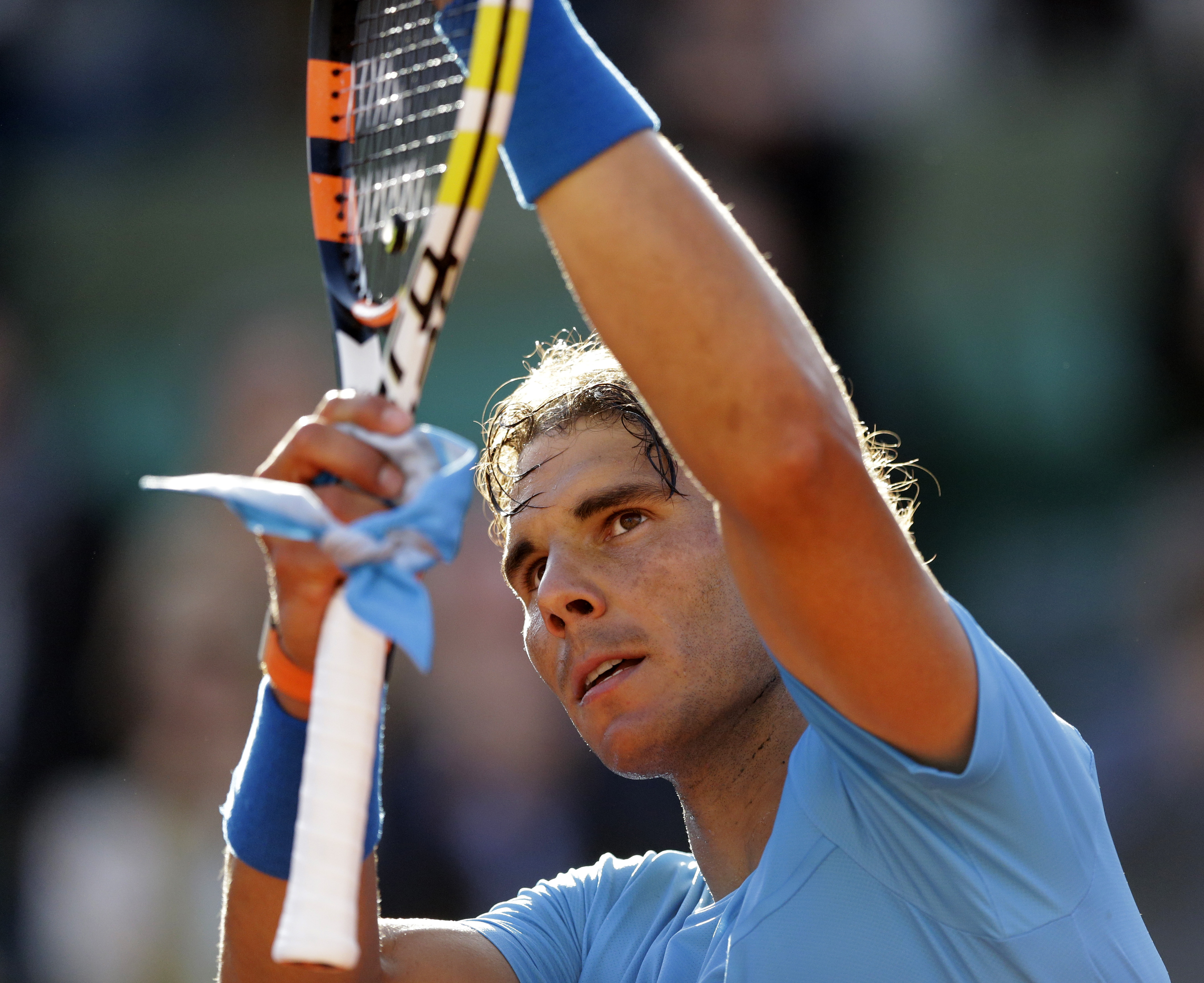 Spain's Rafael Nadal celebrates winning the fourth round match of the French Open tennis tournament against Jack Sock of the U.S. in four sets 6-3, 6-1, 5-7, 6-2, at the Roland Garros stadium, in Paris, France, Monday, June 1, 2015. (AP Photo/Thibault Cam