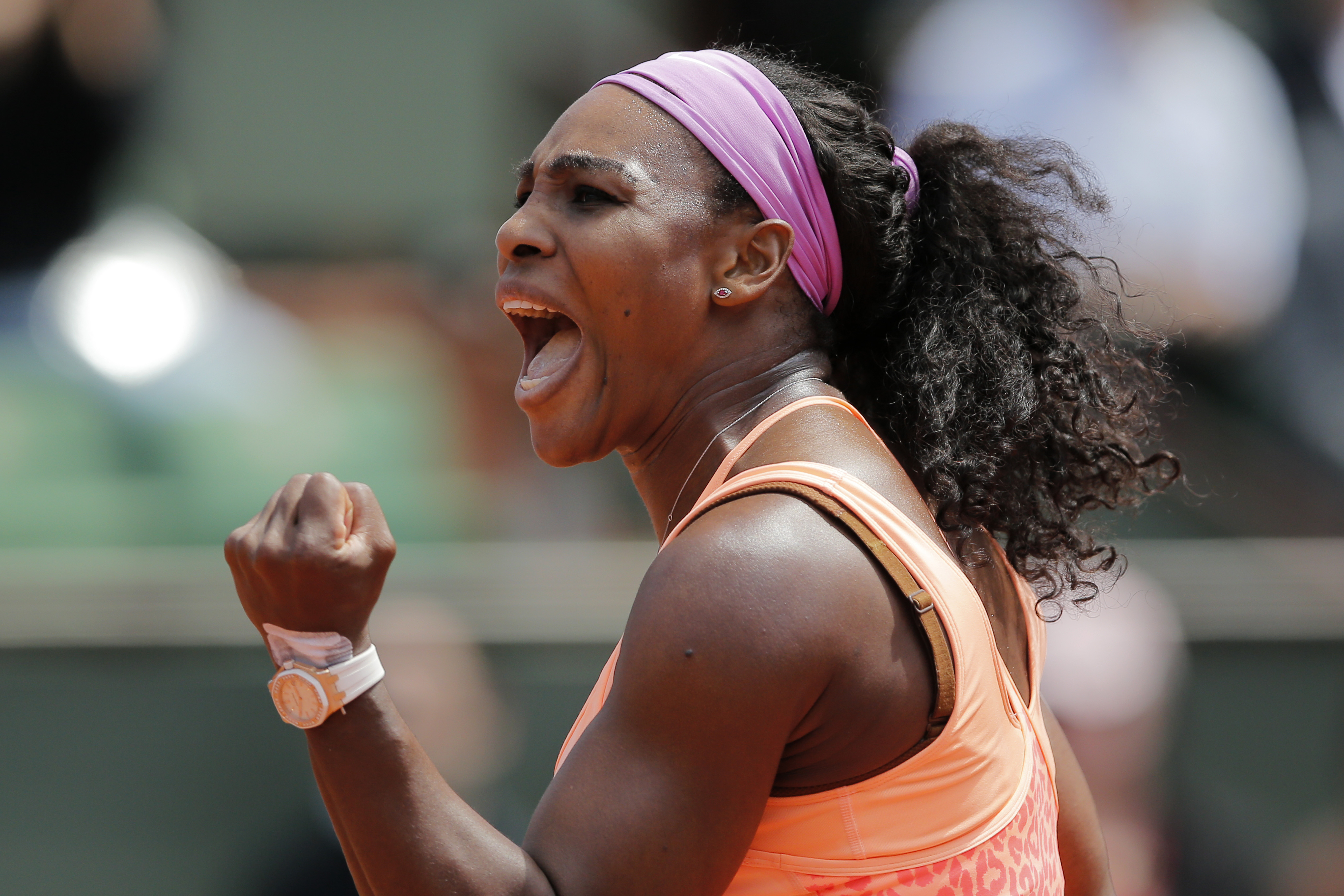 Serena Williams of the U.S. clenches her fist after scoring a point in the quarterfinal match of the French Open tennis tournament against Italy's Sara Errani at the Roland Garros stadium, in Paris, France, Wednesday, June 3, 2015. (AP Photo/Christophe En