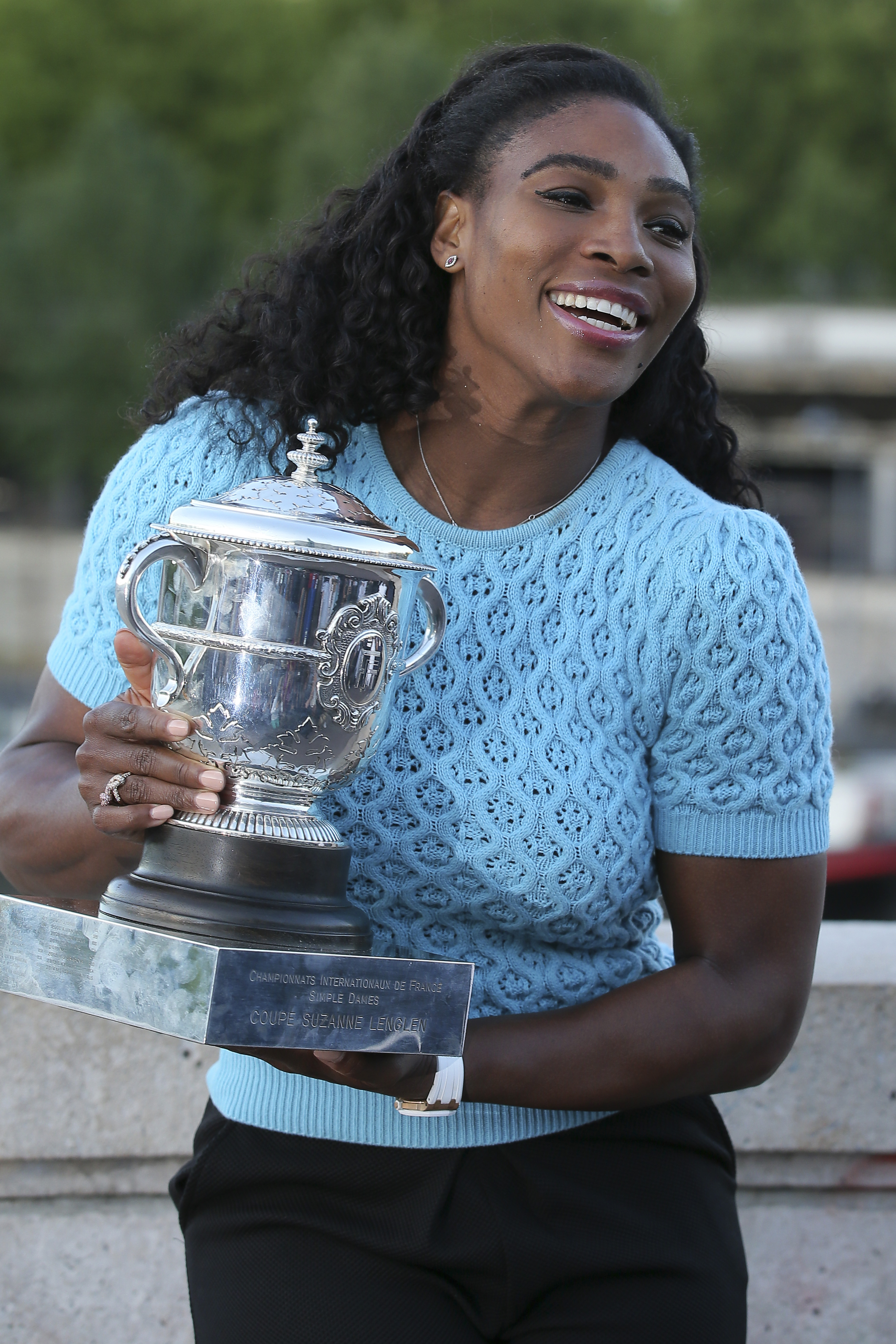 Serena Williams of the U.S. poses with her trophy after defeating Lucie Safarova of the Czech Republic in three sets, 6-3, 6-7, 6-2, in the women's final of the French Open tennis tournament, at Roland Garros stadium in Paris, France, Saturday, June 6, 20