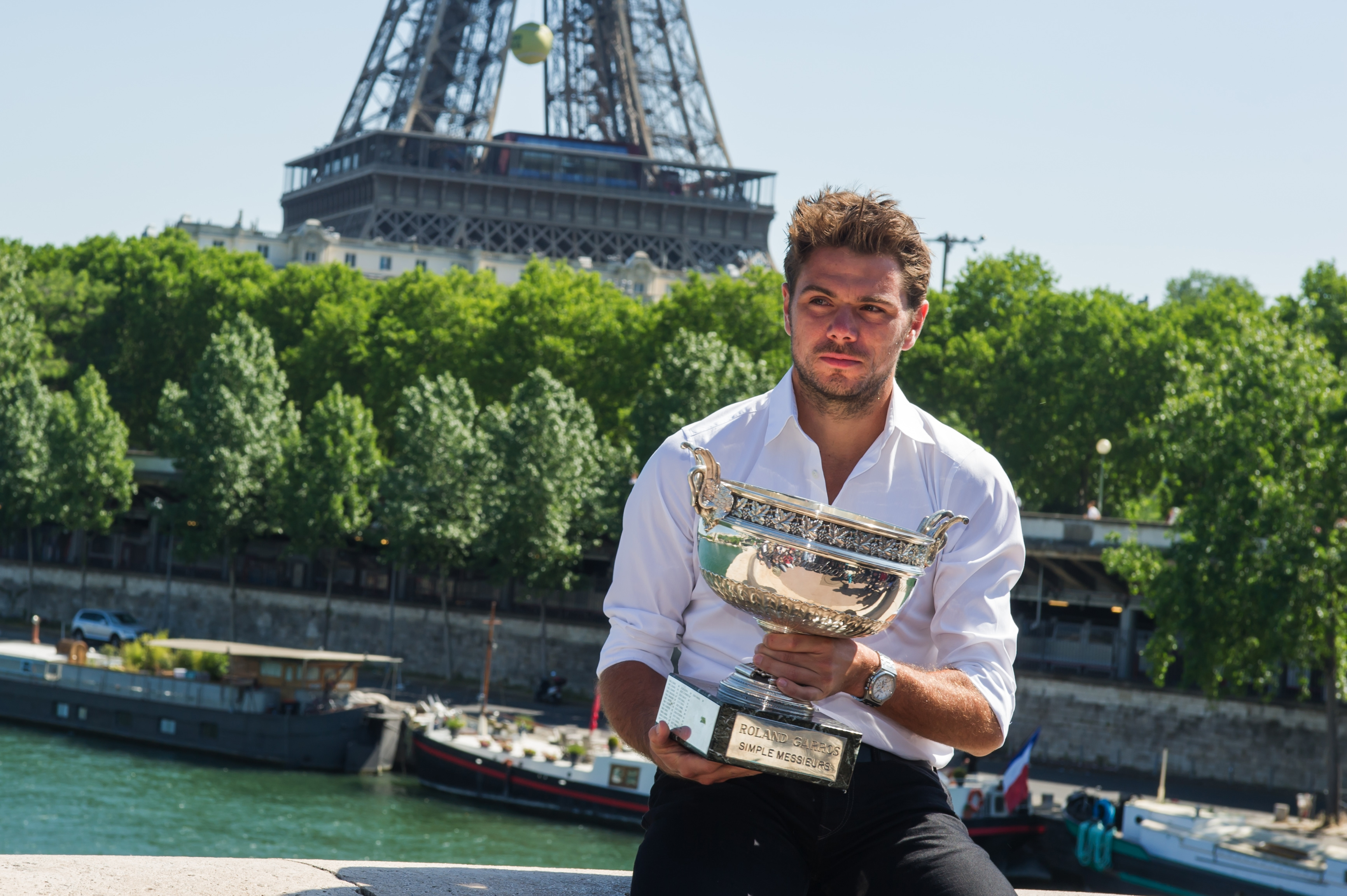 French Open Men's Singles champion Stan Wawrinka of Switzerland poses for a photo with his trophy in front of the Eiffel tower in Paris, France, Monday, June 8, 2015.  Wawrinka defeated Serbia's Novak Djokovic  in four sets, 4-6, 6-4, 6-3, 6-4, in the men