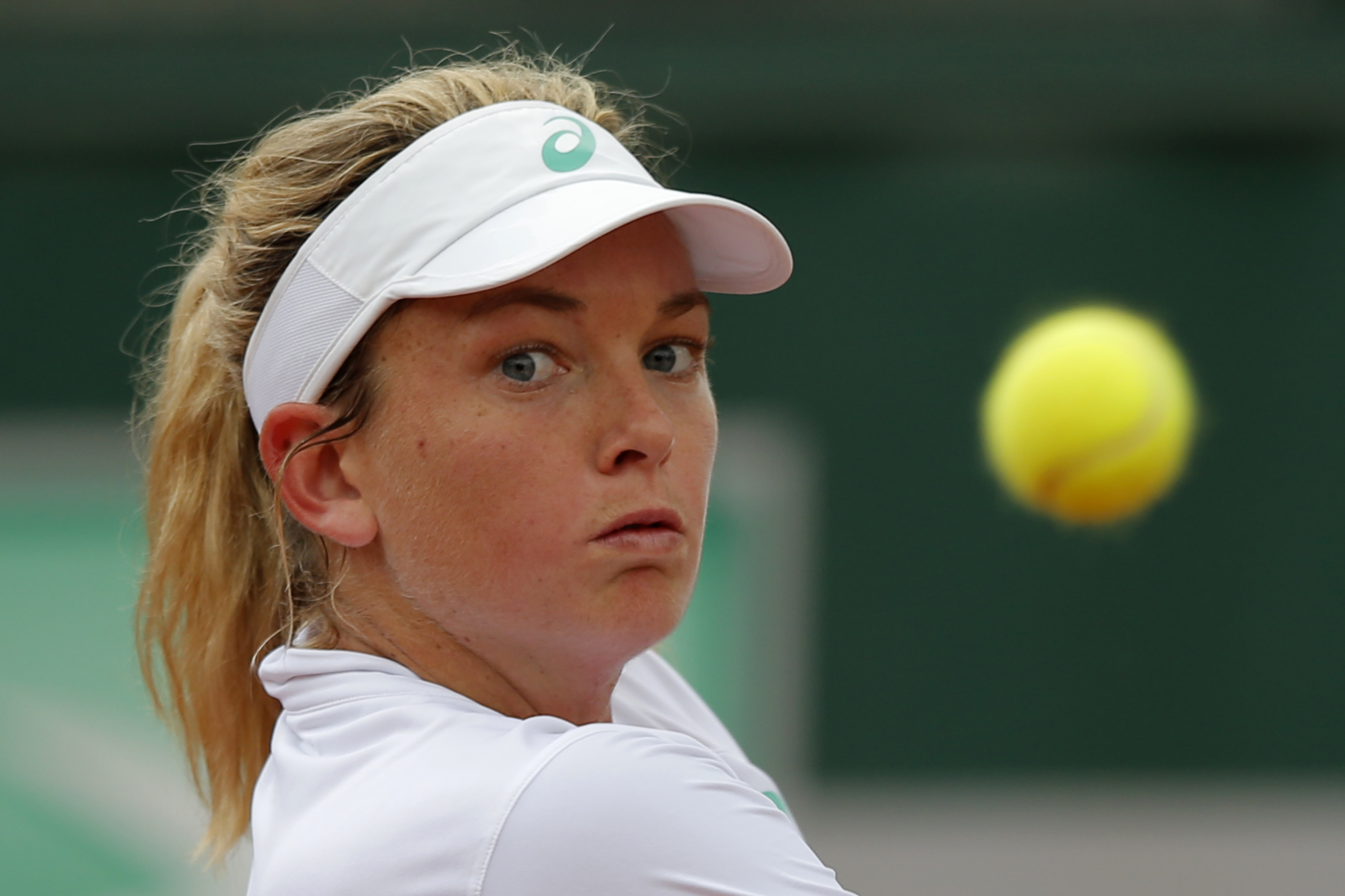 USA's Coco Vandeweghe eyes the ball as she plays Germany's Julia Goerges during their first round match of the French Open tennis tournament at the Roland Garros stadium, Tuesday, May 26, 2015 in Paris . (AP Photo/Francois Mori)