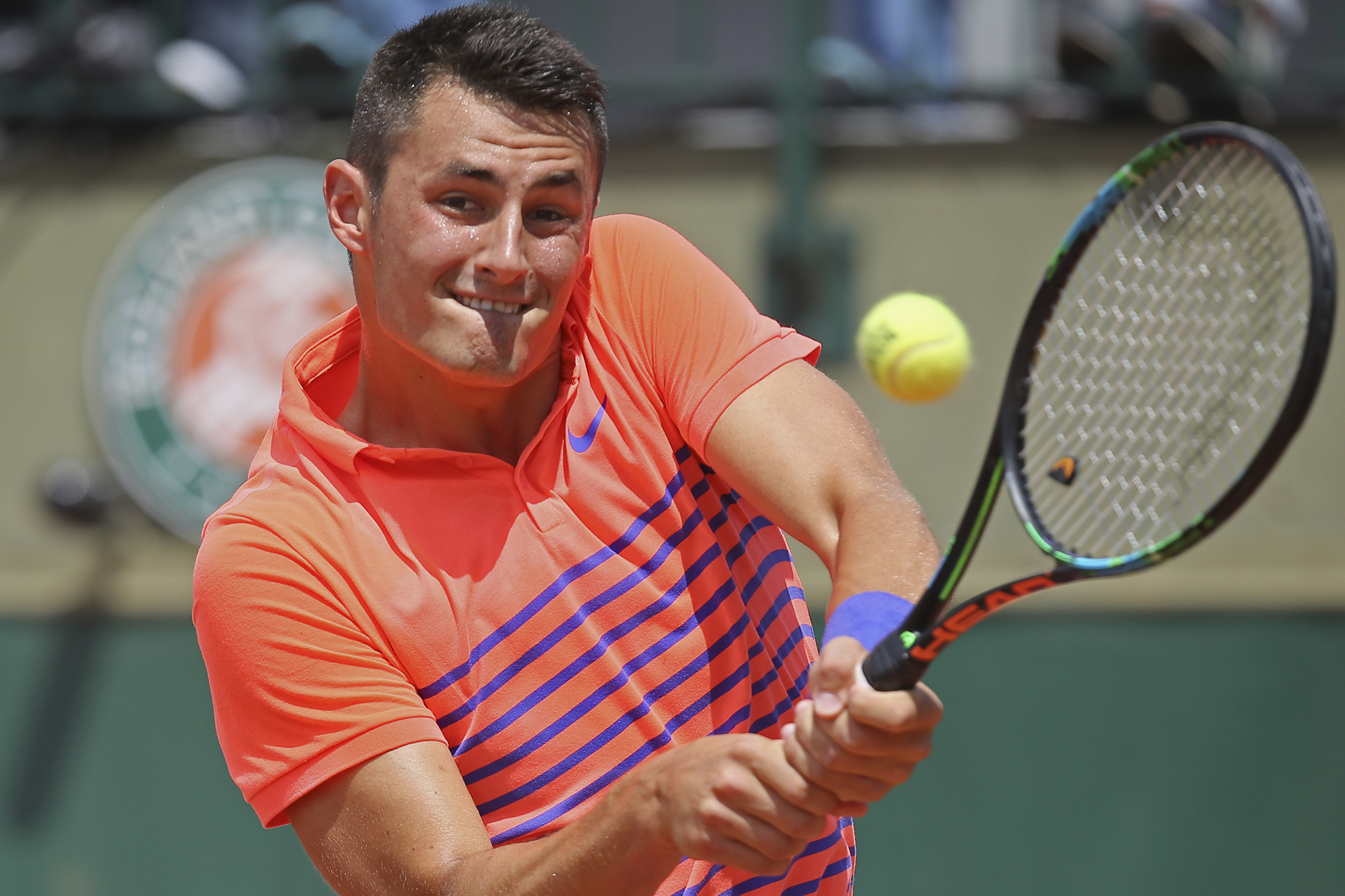 Australia's Bernard Tomic returns in the first round match of the French Open tennis tournament against Italy's Luca Vanni at the Roland Garros stadium, in Paris, France, Monday, May 25, 2015. (AP Photo/David Vincent)