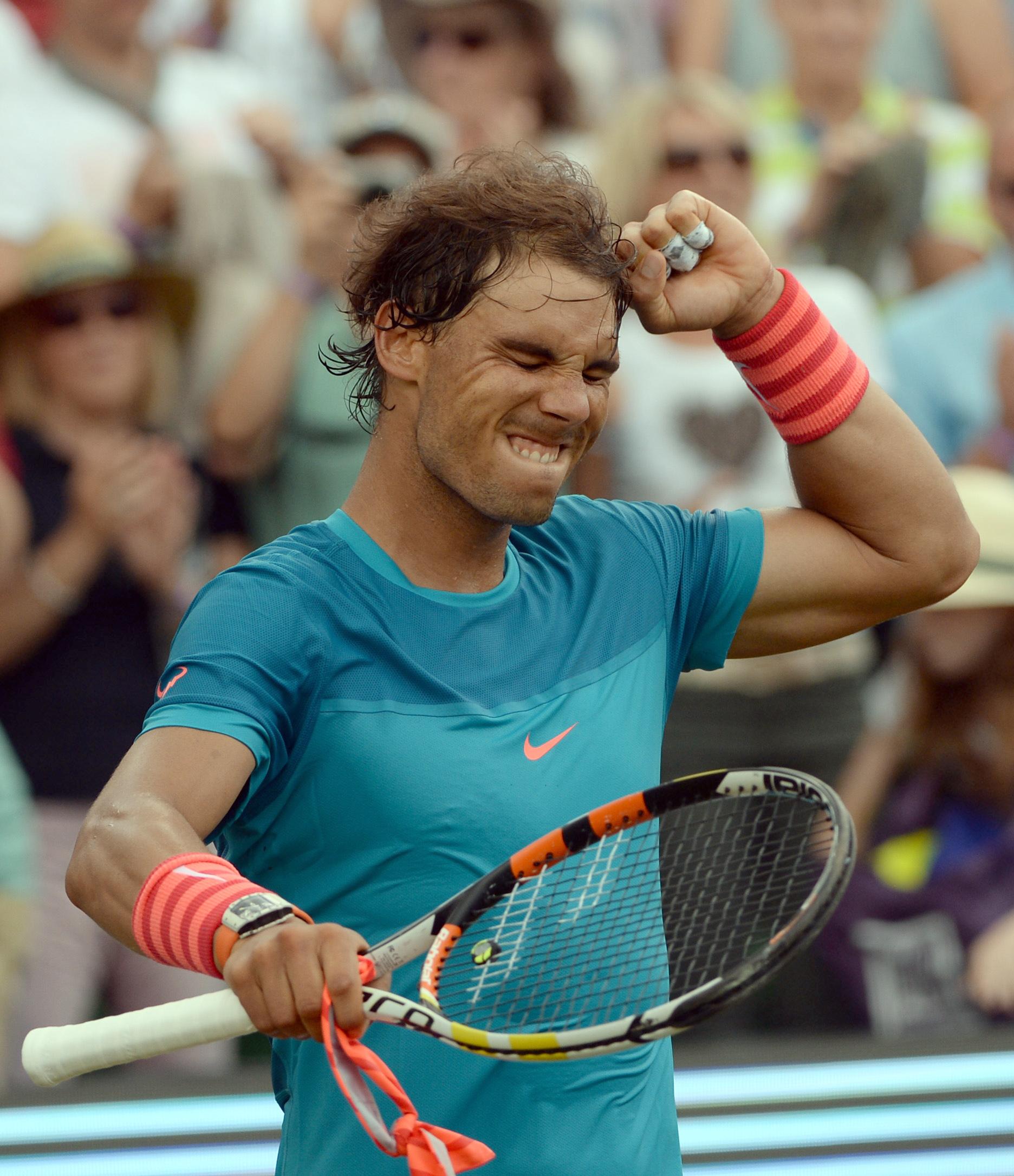 Spain's Rafael Nadal  celebrates  after he won the semifinal tennis match against Gael Monfils from France, at the ATP Mercedes Cup tennis tournament in Stuttgart, Germany, Saturday June 13, 2015. ( Marijan Murat/dpa, via AP)