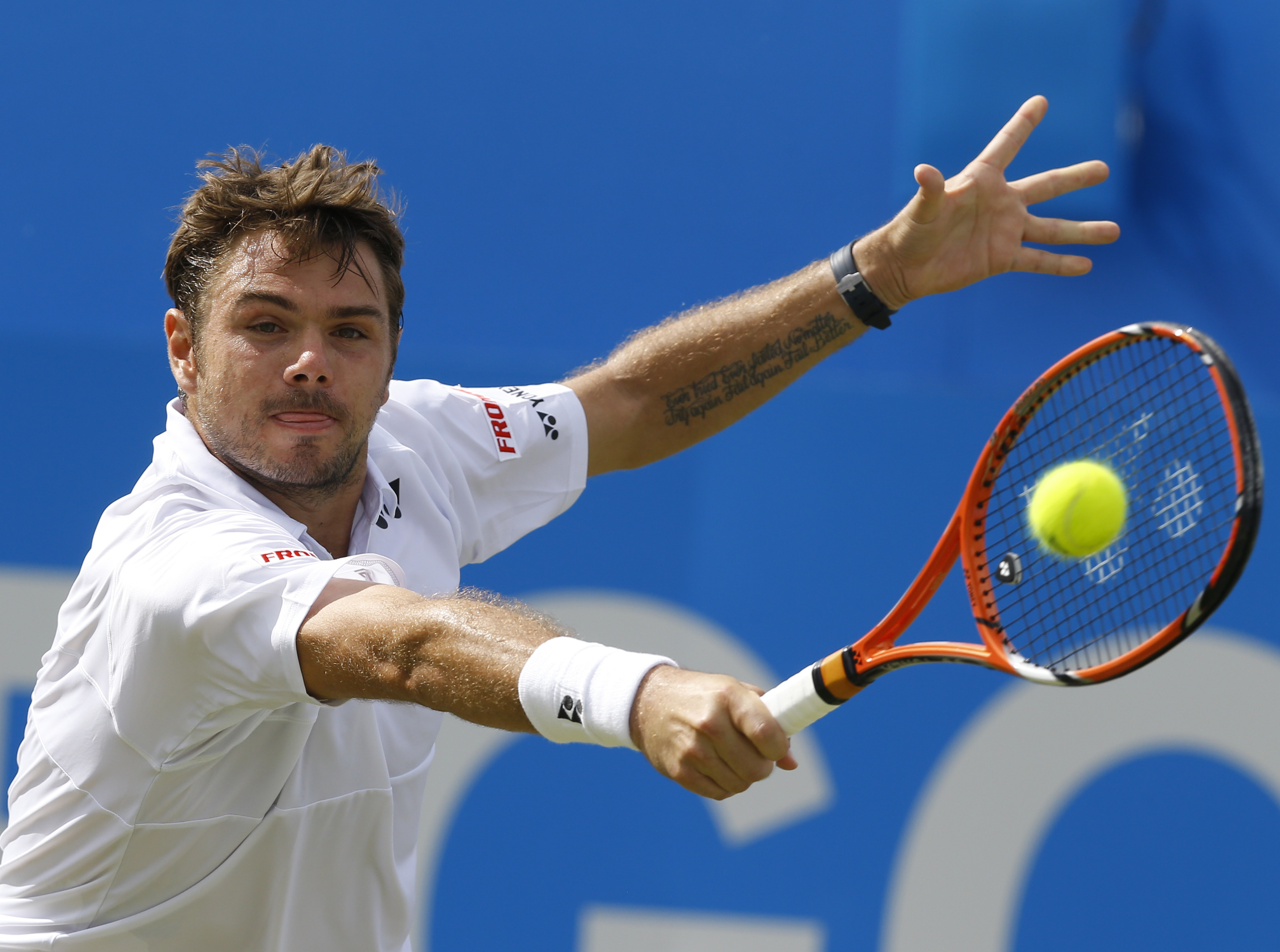 Switzerland's Stan Wawrinka returns a shot to South Africa's Kevin Anderson, during their men's singles tennis match of  the Queen's tennis championship, in London, Wednesday, June 17, 2015. (AP Photo/Kirsty Wigglesworth)