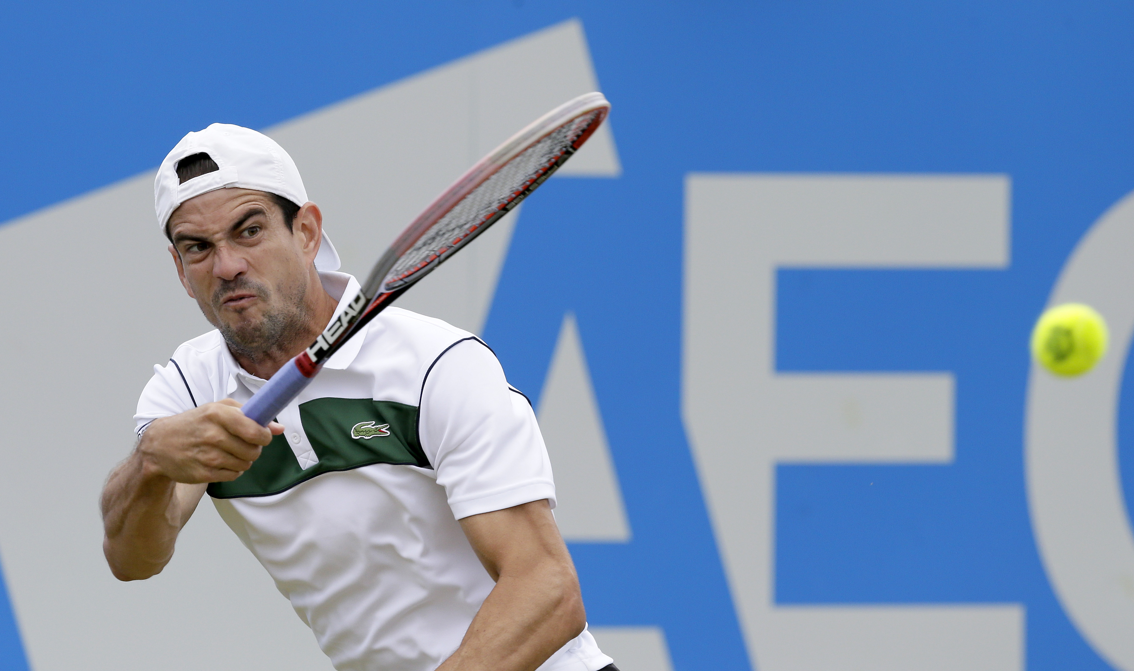 Spain's Guillermo Garcia-Lopez plays a return to South Africa's Kevin Anderson during their quarterfinal tennis match on the fifth day of the Queen's Championships in London, Friday, June 19, 2015. (AP Photo/Tim Ireland)