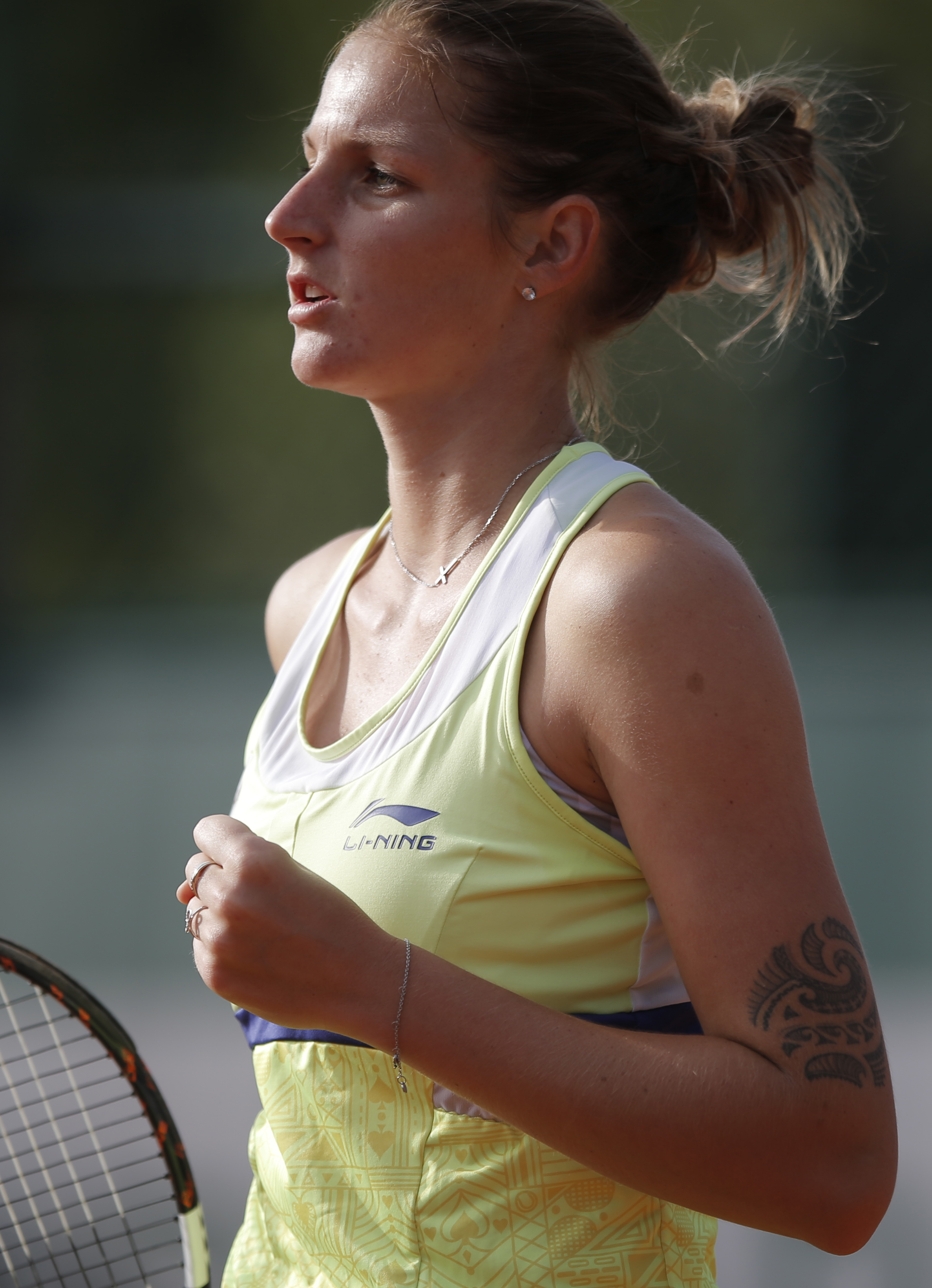 Karolina Pliskova of the Czech Republic, reacts as she plays China's Shuai Zhang during their first round match of the French Open tennis tournament at the Roland Garros stadium, Monday, May 25, 2015 in Paris,  (AP Photo/Francois Mori)