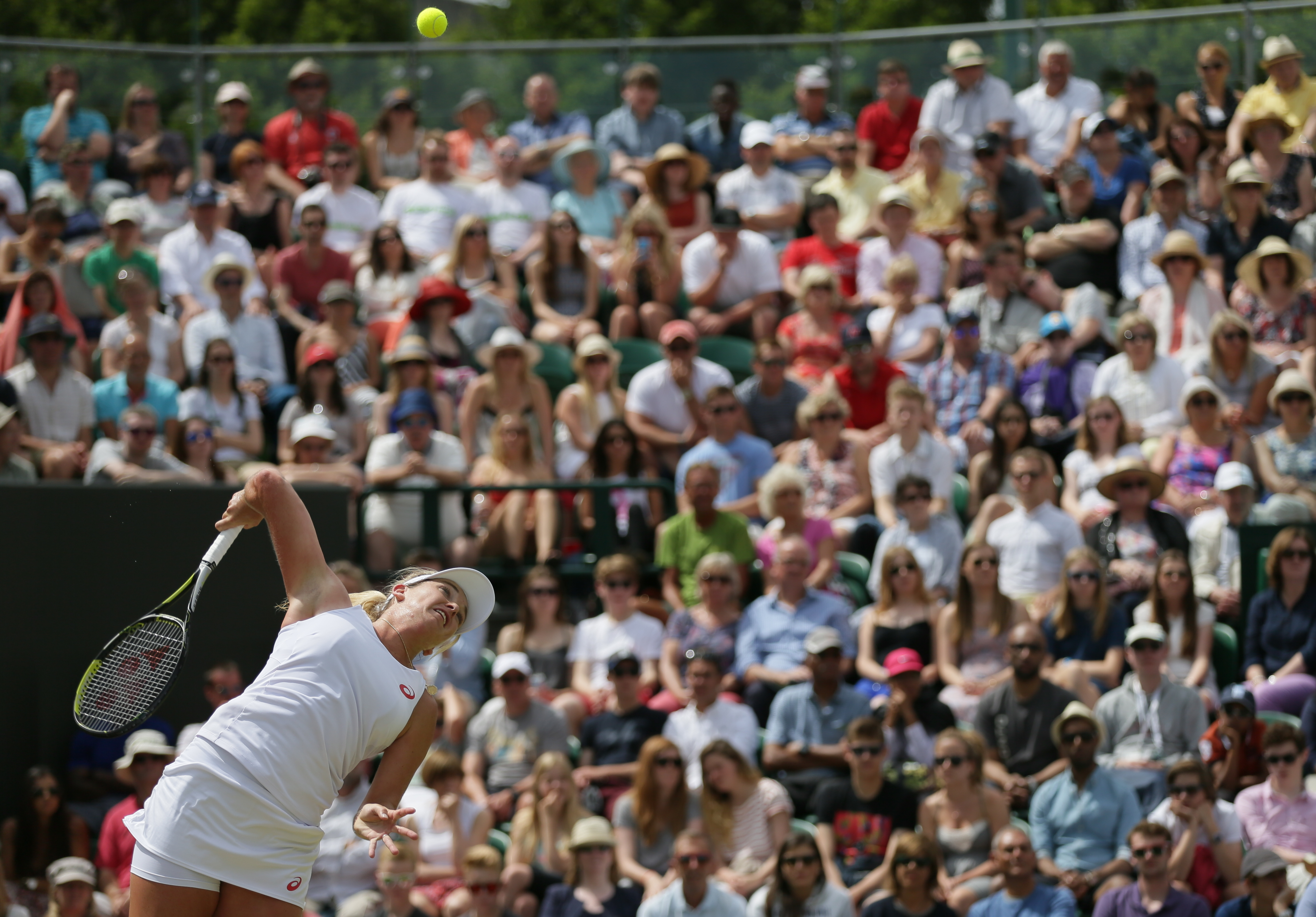 Coco Vandeweghe of the United States serves to Lucie Safarova of the Czech Republic during their singles match at the All England Lawn Tennis Championships in Wimbledon, London, Monday July 6, 2015. (AP Photo/Tim Ireland)