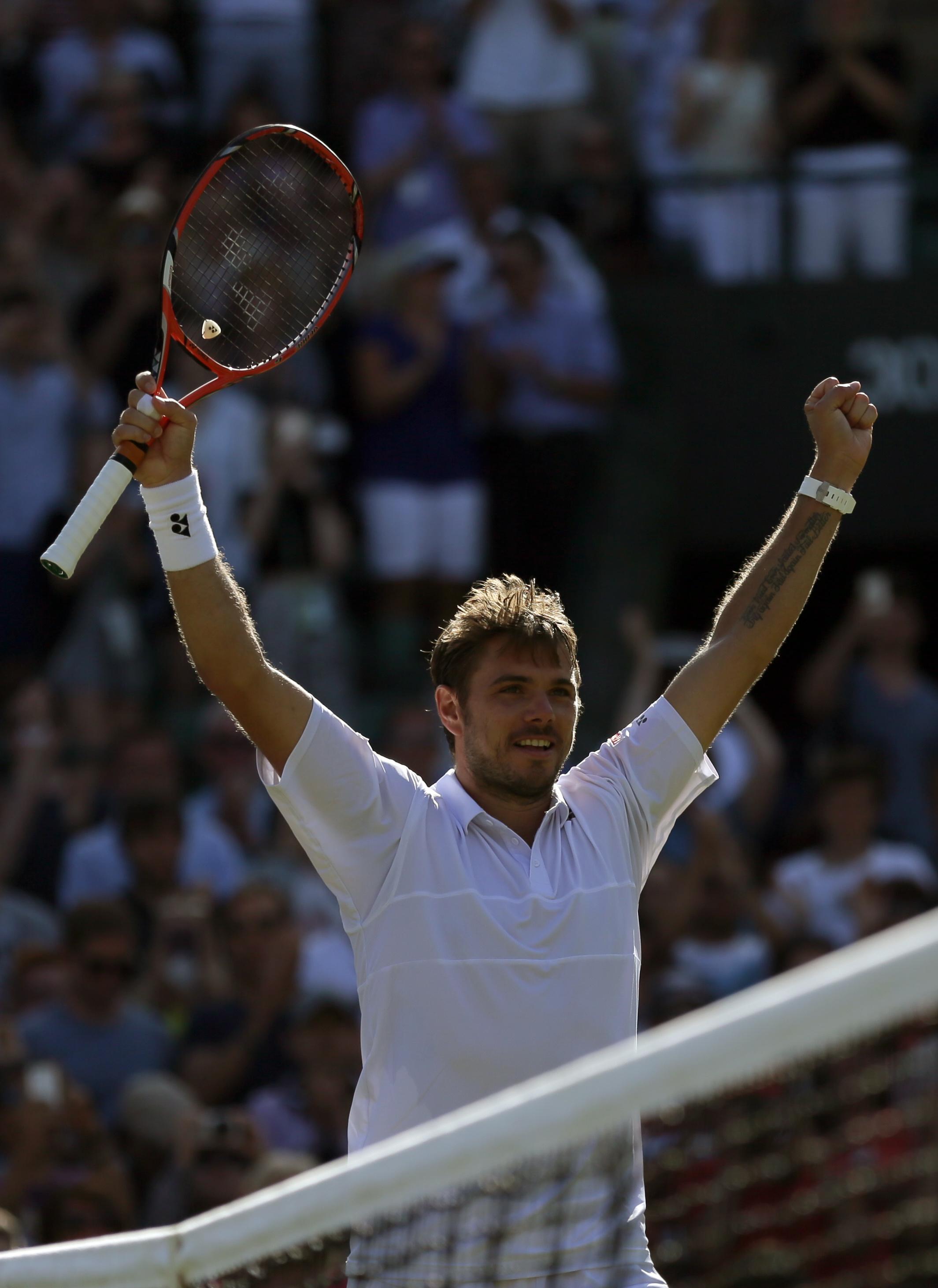 Stan Wawrinka of Switzerland celebrates winning the match against David Goffin of Belgium, at the All England Lawn Tennis Championships in Wimbledon, London, Monday July 6, 2015. Wawrinka won the match 7-6, 7-6, 6-4. (AP Photo/Tim Ireland)