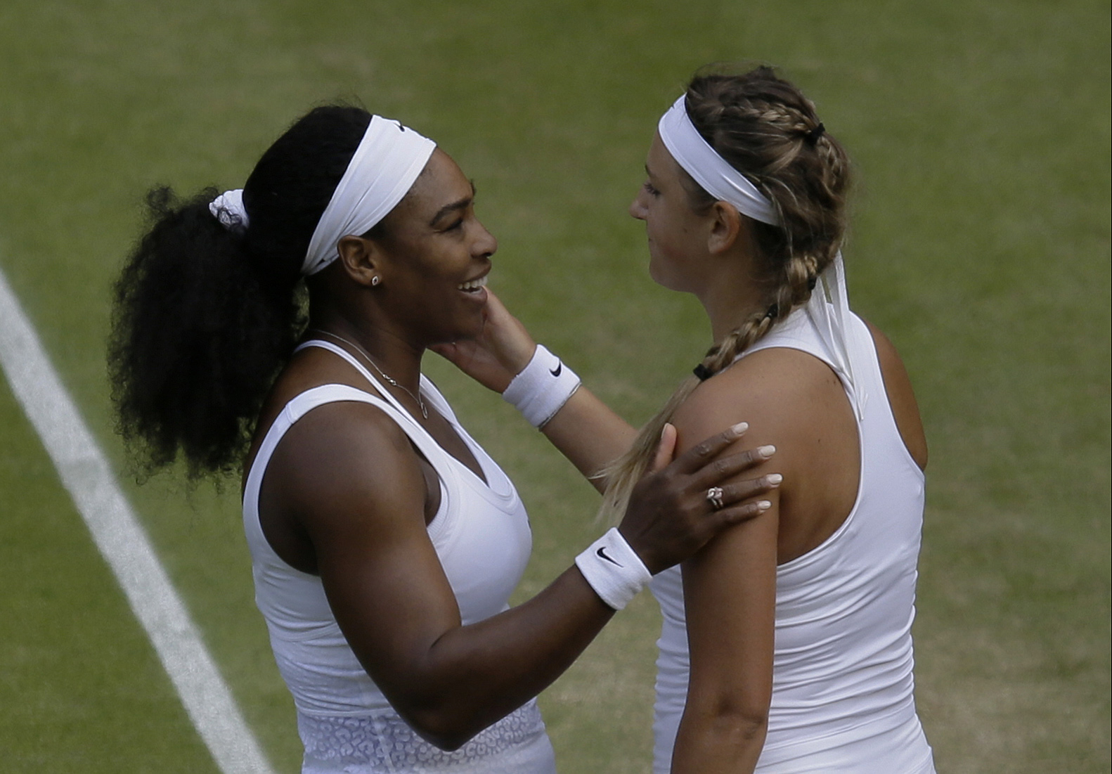 Serena Williams of the United States talks to Victoria Azarenka of Belarus, after defeating her in their singles match, at the All England Lawn Tennis Championships in Wimbledon, London, Tuesday July 7, 2015. Williams won 3-6, 6-2, 6-3.  (AP Photo/Pavel G