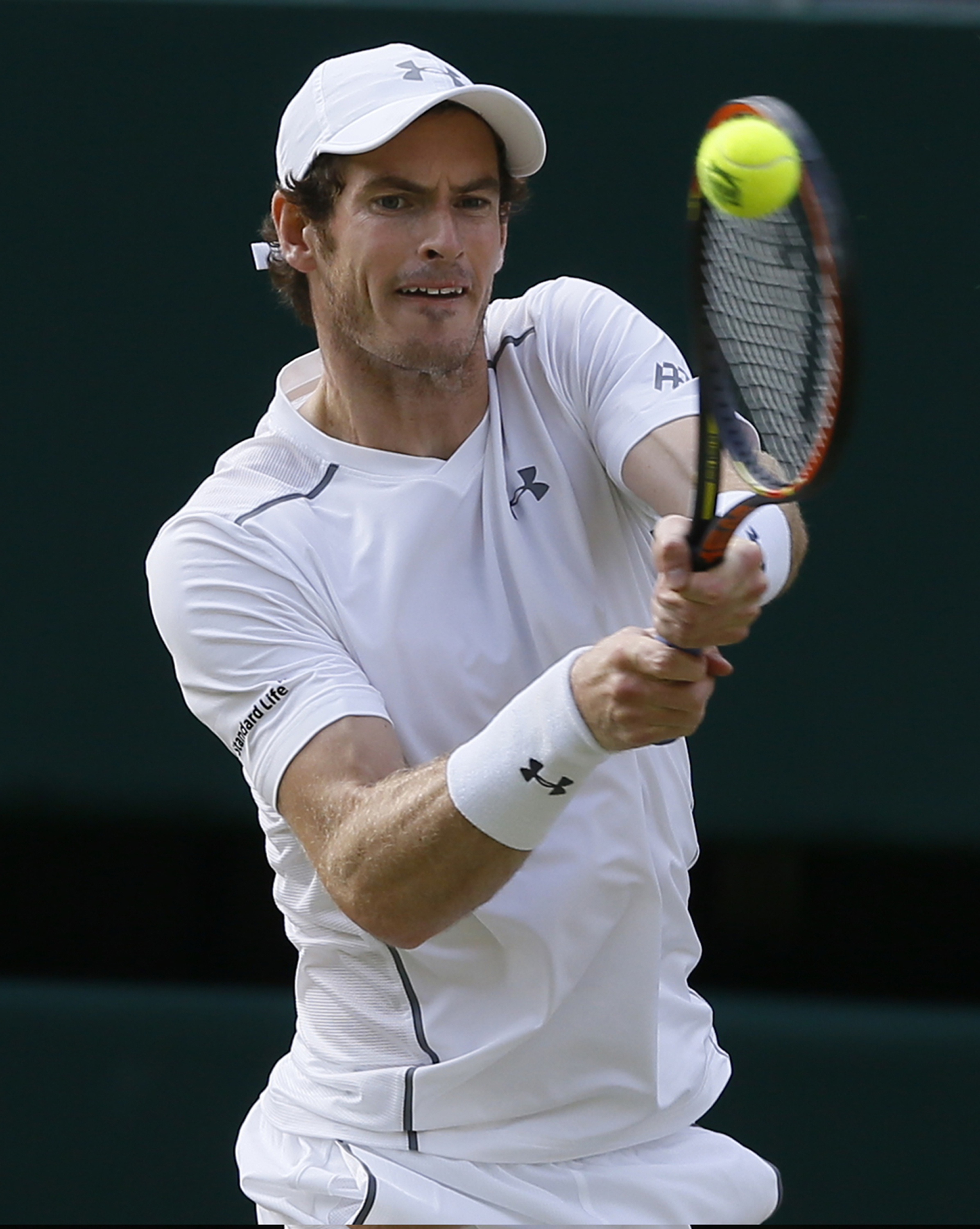 Andy Murray of Britain plays a shot to Roger Federer of Switzerland during the men's singles semifinal match at the All England Lawn Tennis Championships in Wimbledon, London, Friday July 10, 2015. (AP Photo/Kirsty Wigglesworth)