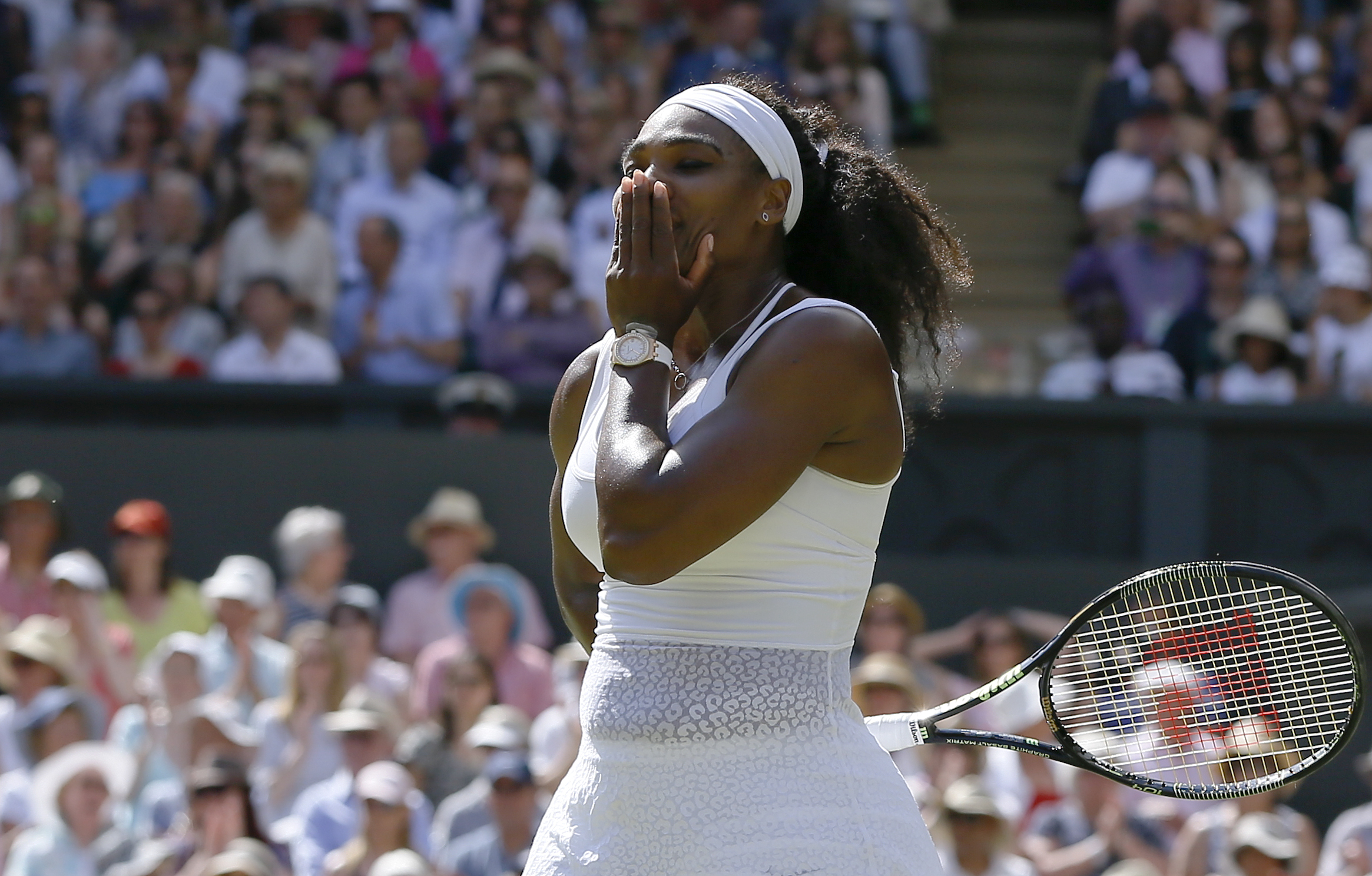 Serena Williams of the United States  celebrates winning the singles match Garbine Muguruza of Spain after the women's singles final at the All England Lawn Tennis Championships in Wimbledon, London, Saturday July 11, 2015. Williams won 6-4, 6-4.  (AP Pho