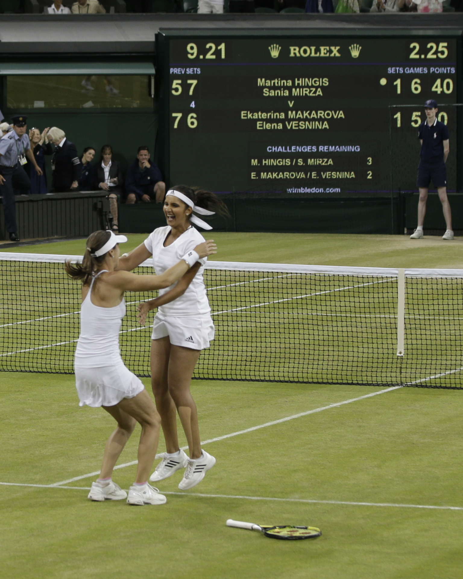 Martina Hingis of Switzerland, left, and Sania Mirza of India celebrate winning the women's doubles final against Ekaterina Makarova of Russia and Elena Vesnina of Russia at the All England Lawn Tennis Championships in Wimbledon, London, Saturday July 11,
