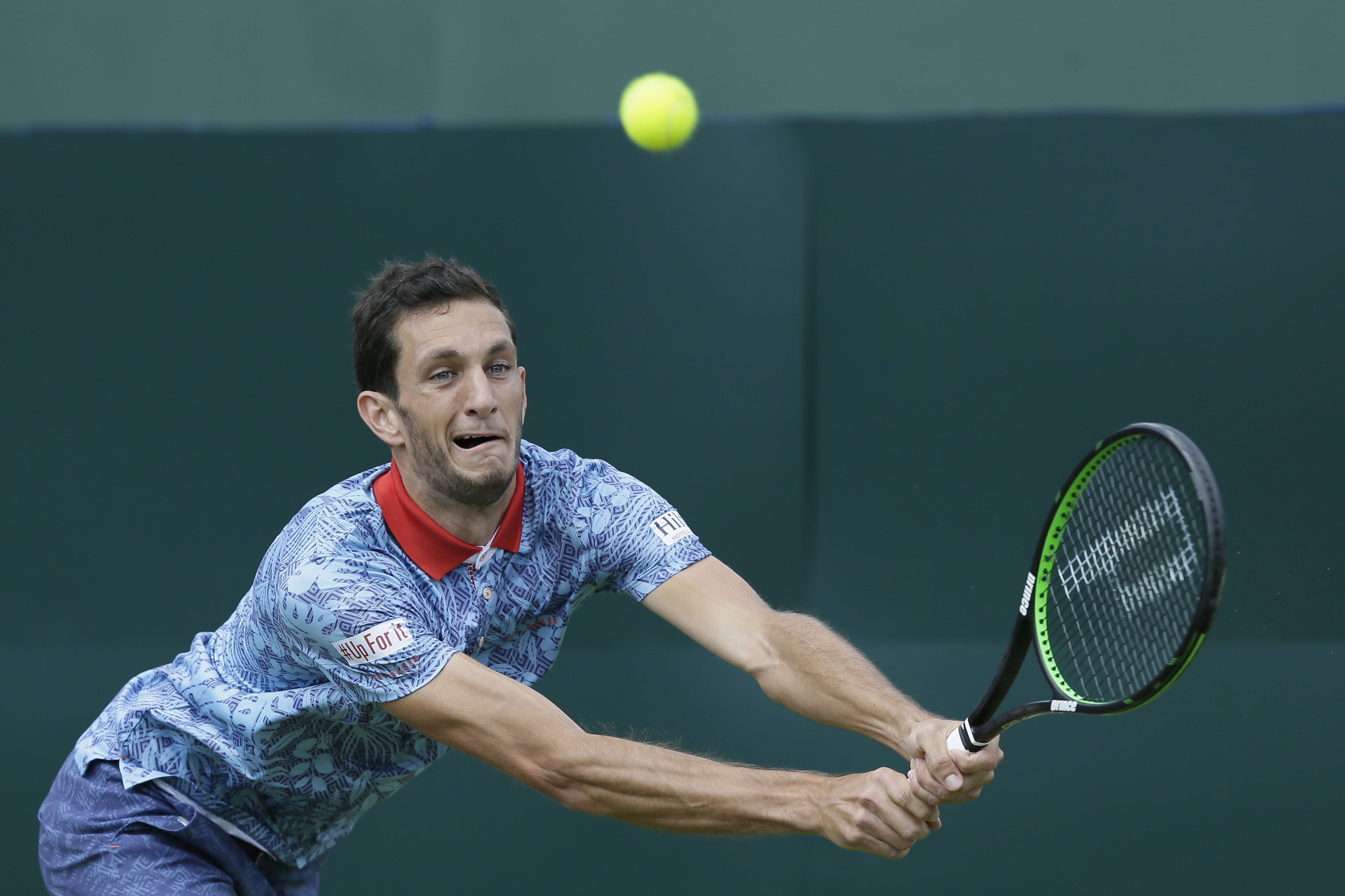 Britain's James Ward plays a return to France's Gilles Simon during the quarterfinal match between Britain and France in the Davis Cup at the Queen's Club in London, Friday July 17, 2015. (AP Photo/Tim Ireland)