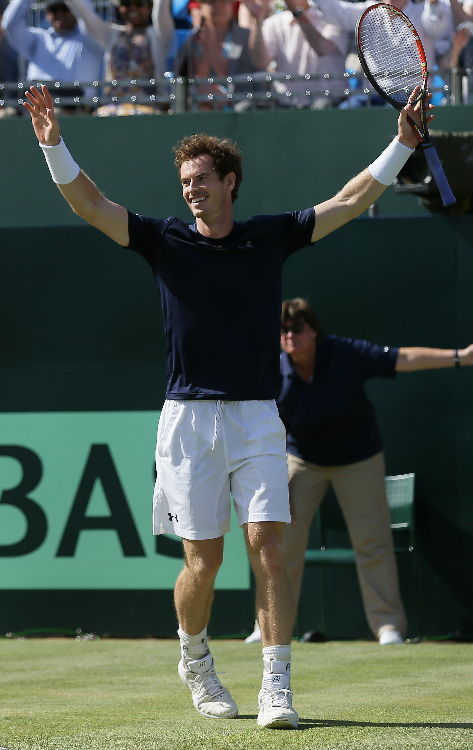 Britain's Andy Murray celebrates beating France's Gilles Simon, taking Britain to the semifinal stage, during the quarterfinal tennis matches of the Davis Cup at the Queen's Club in London, Sunday July 19, 2015. (AP Photo/Tim Ireland)