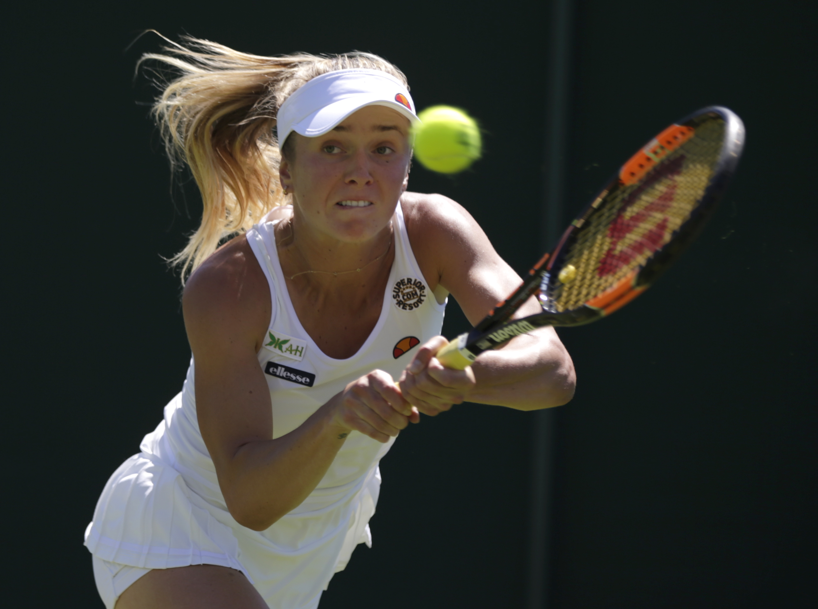 Elina Svitolina of the Ukraine plays a return to Misaki Doi of Japan during the women's singles first round match at the All England Lawn Tennis Championships in Wimbledon, London, Tuesday June 30, 2015. (AP Photo/Pavel Golovkin)
