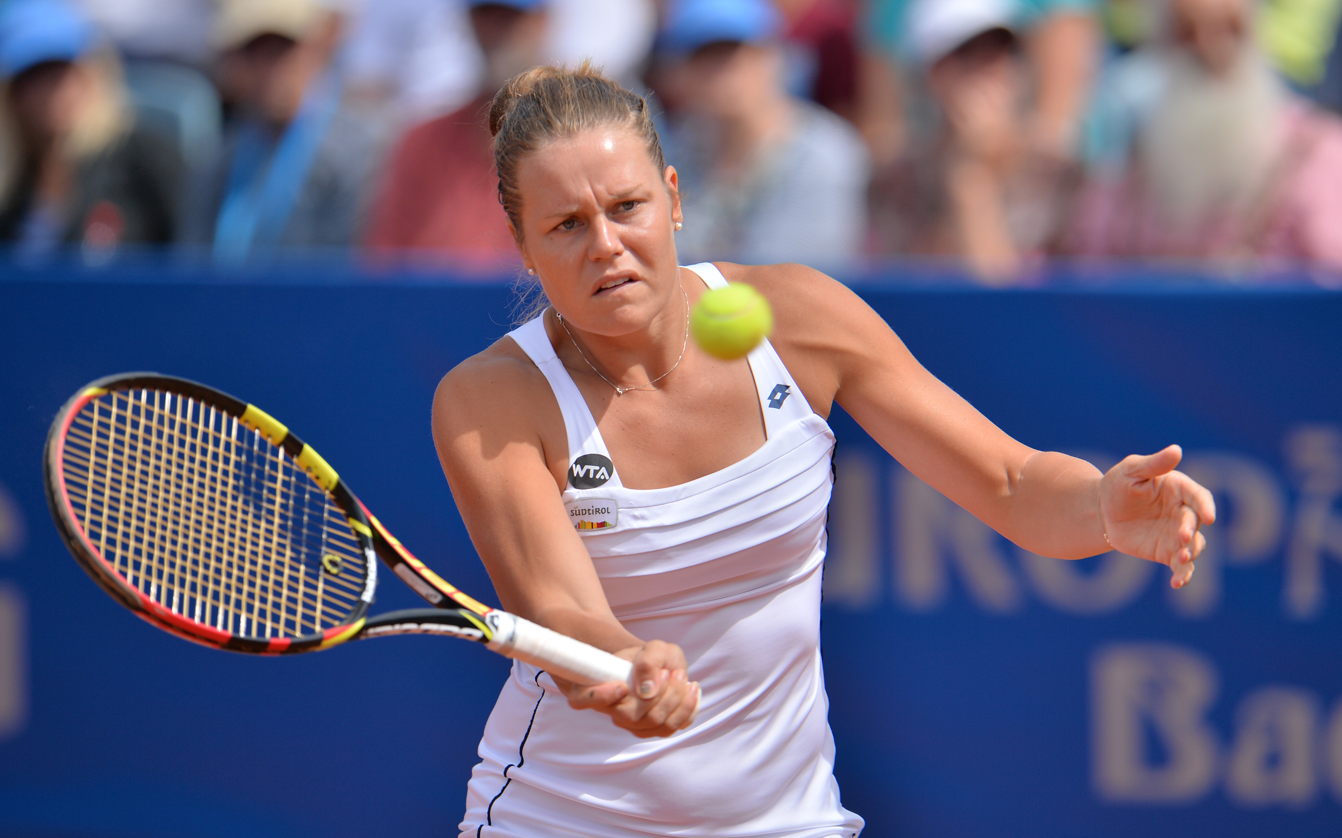 Karin Knapp from Italy returns the ball during her final match against Australia's Samantha Stosur at the WTA tennis tournament in Bad Gastein, Austria, on Sunday, July. 26, 2015. Stosur won with 3-6, 7-6 and 6-2. (AP Photo/Kerstin Joensson)