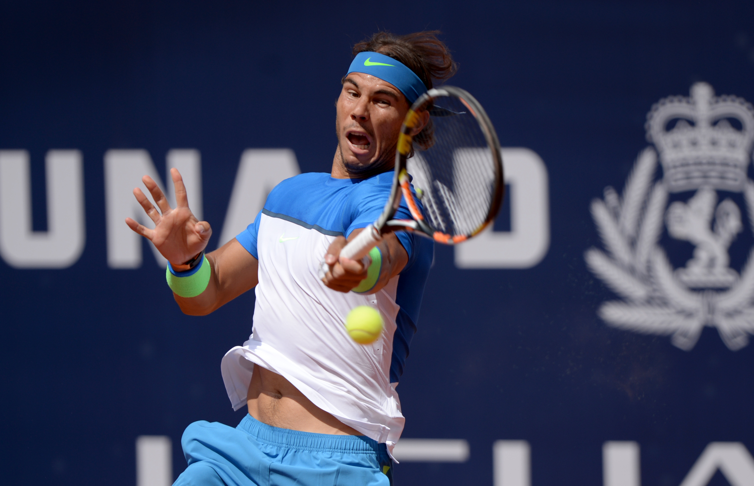 Spain's Rafael Nadal  returns a shot  to Fabio Fognini from Italy during the final match of  the ATP tennis tournament in Hamburg, Germany, Sunday Aug. 2, 2015.  (Daniel Reinhardt/dpa via AP)
