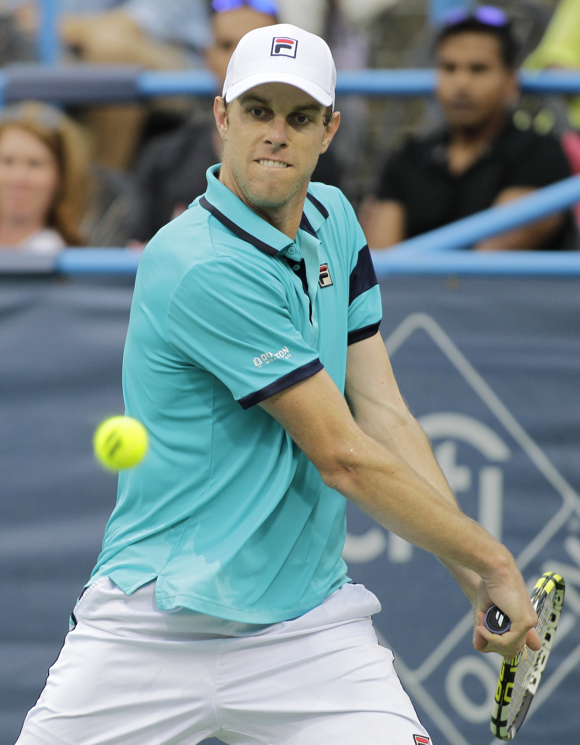 Sam Querrey, of the United States, returns the ball to Marin Cilic, of Croatia, during the Citi Open tennis tournament, Thursday, Aug. 6, 2015, in Washington. (AP Photo/Luis M. Alvarez)