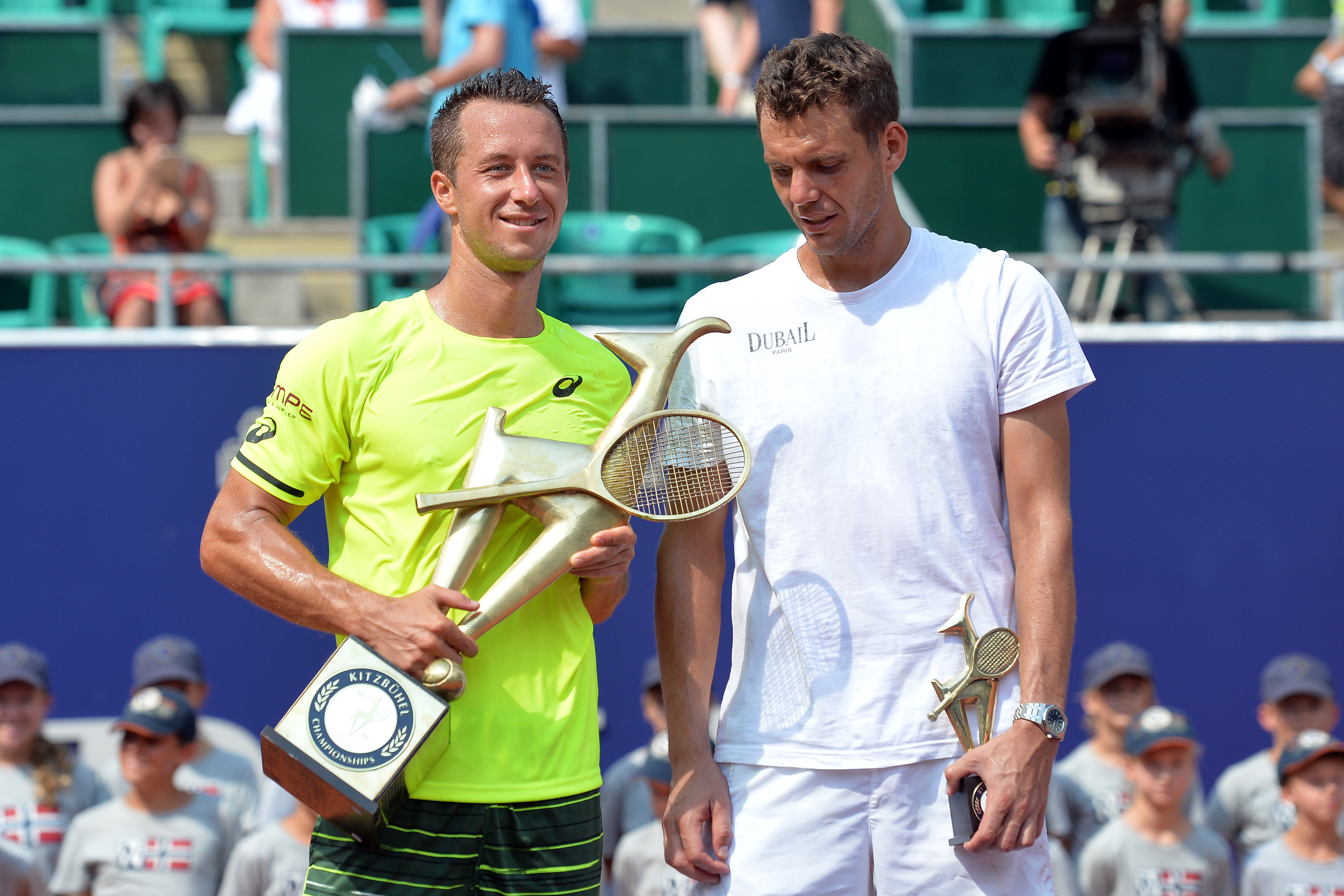 Germany's winner Philipp Kohlschreiber, left, and France's Paul-Henri Mathieu pose for media after their final match at the Generali Open tennis tournament in Kitzbuehel, Austria, Saturday, Aug. 8, 2015.  Kohlschreiber won with 2-6, 6-2 and 6-2. (AP Photo