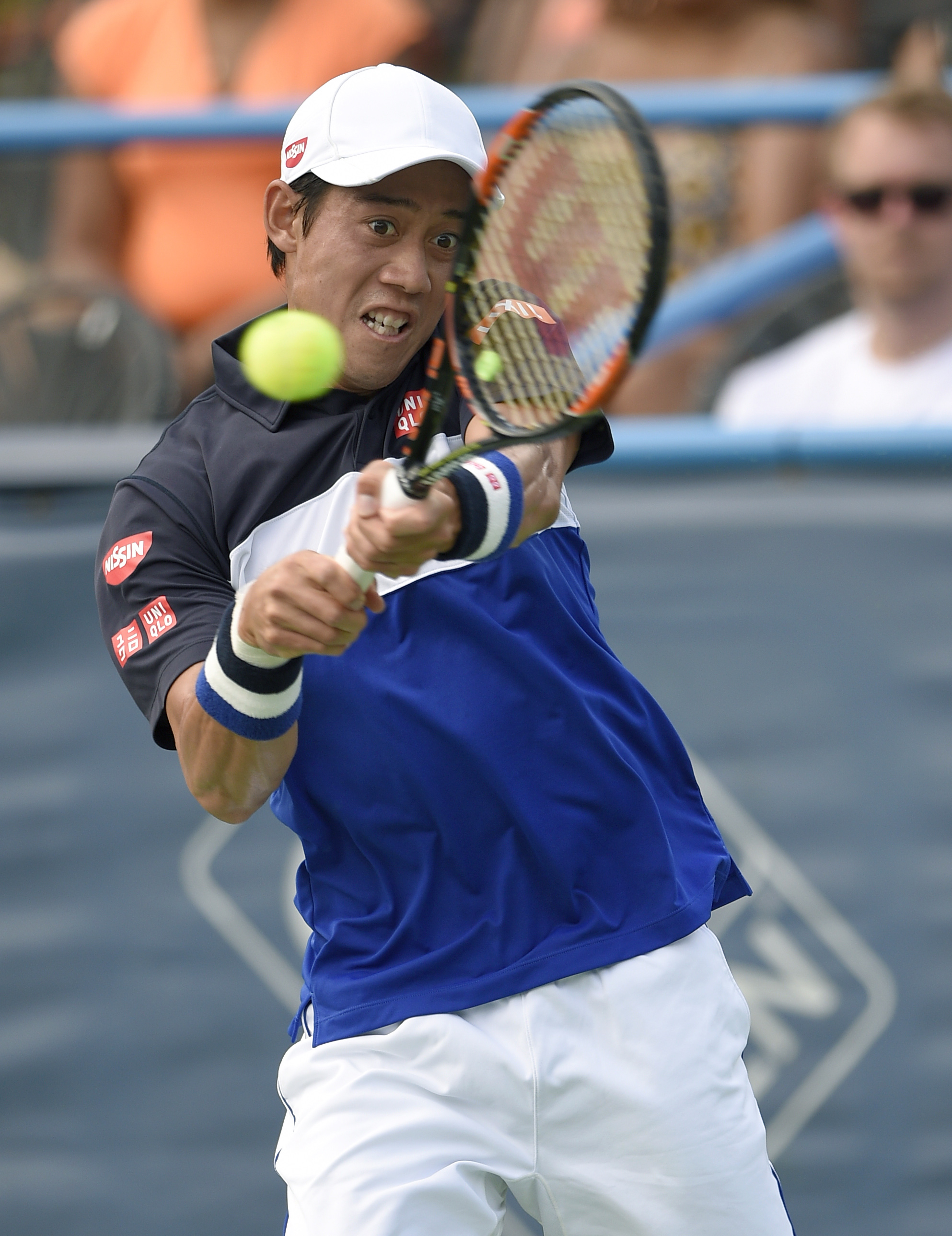 Kei Nishikori, of Japan, returns the ball against Marin Cilic, of Croatia, at the Citi Open tennis tournament, Saturday, Aug. 8, 2015, in Washington. (AP Photo/Nick Wass)