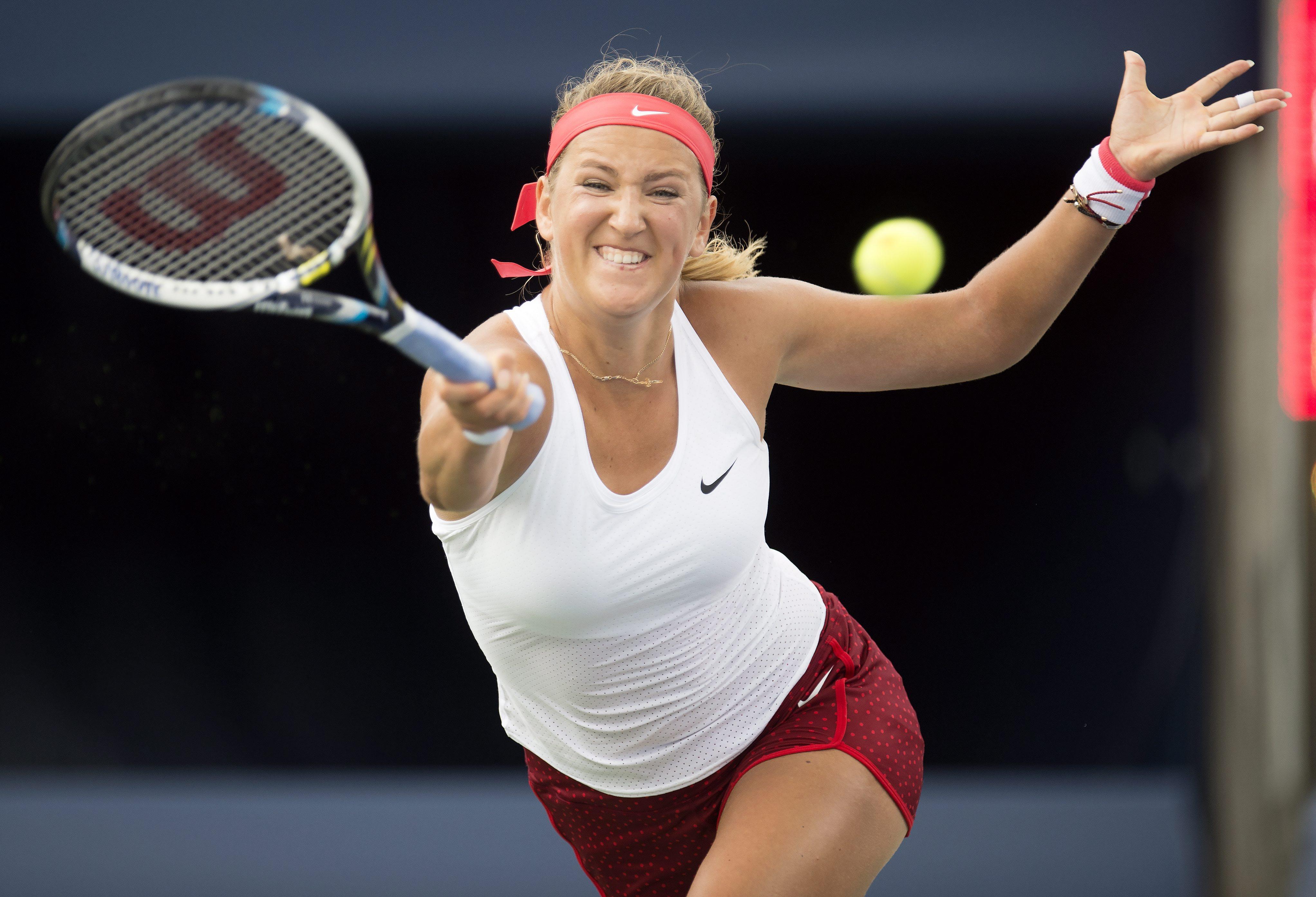 Victoria Azarenka, of Belarus, hits a return to Elina Svitolina, of Ukraine, at the Rogers Cup tennis tournament in Toronto, Tuesday Aug. 11, 2015.  (Frank Gunn/The Canadian Press via AP)