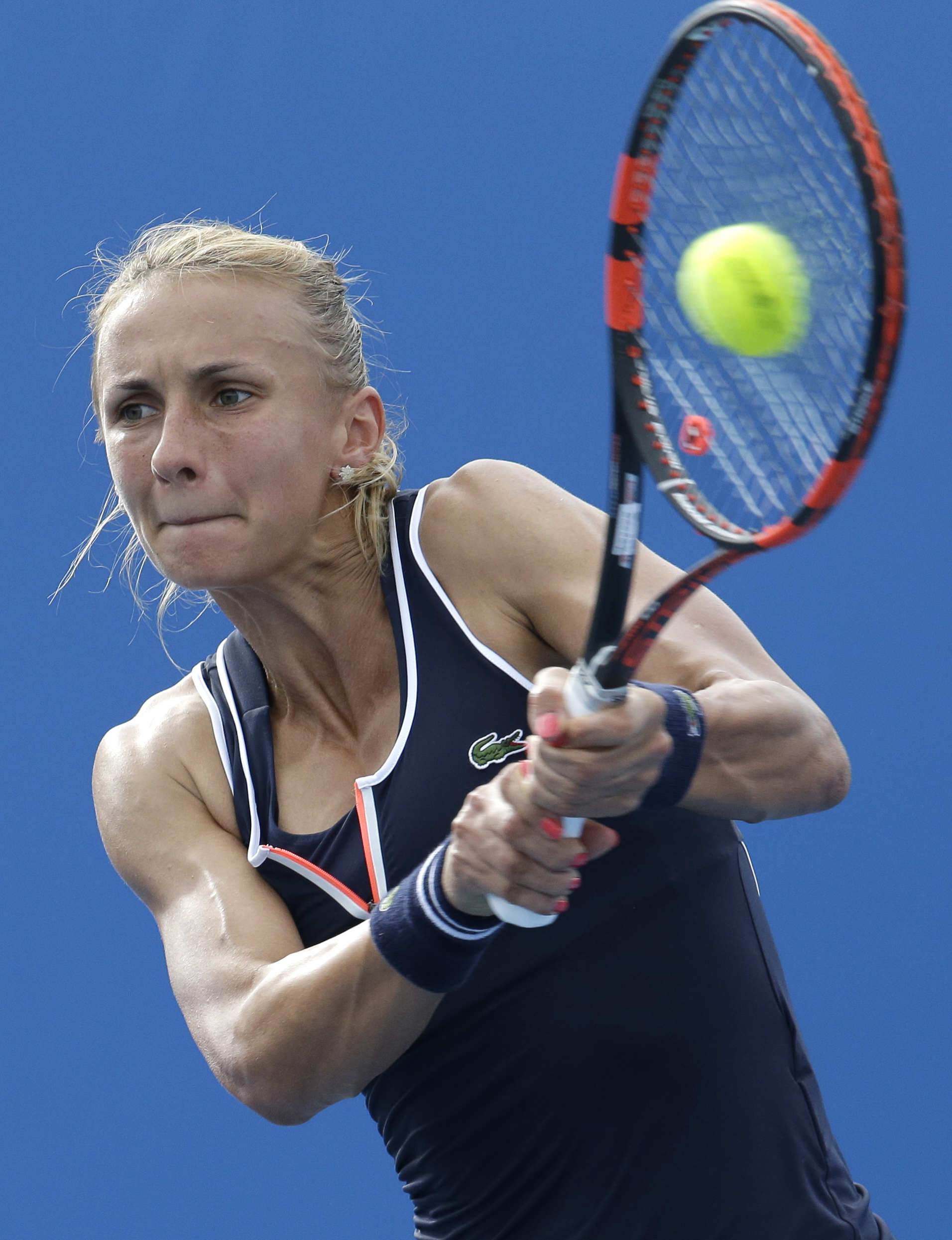 Lesia Tsurenko of Ukraine makes a backhand return to Madison Keys of the U.S. during their first round match at the Australian Open tennis championship in Melbourne, Australia, Tuesday, Jan. 20, 2015. (AP Photo/Lee Jin-man)