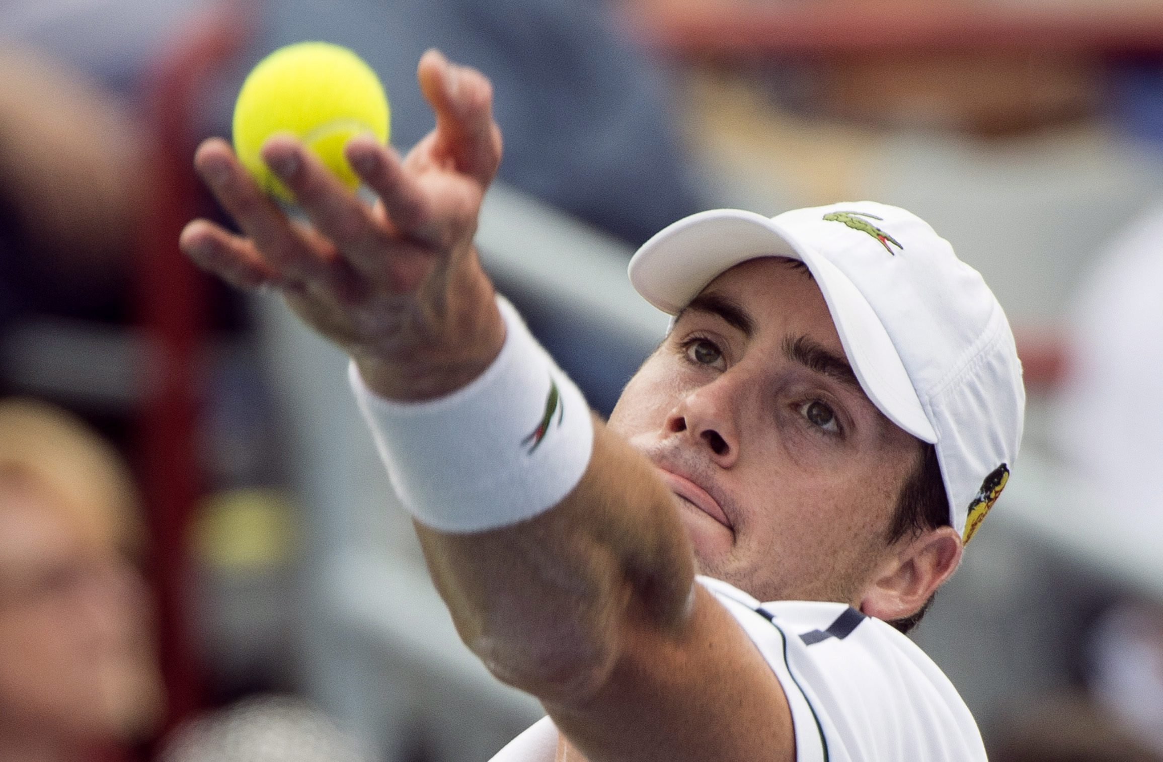 John Isner, of the United States, tosses the ball to serve to Jeremy Chardy, of France, during the quarter-finals at the Rogers Cup tennis tournament Friday Aug. 14, 2015 in Montreal. (Paul Chiasson/The Canadian Press via AP) MANDATORY CREDIT