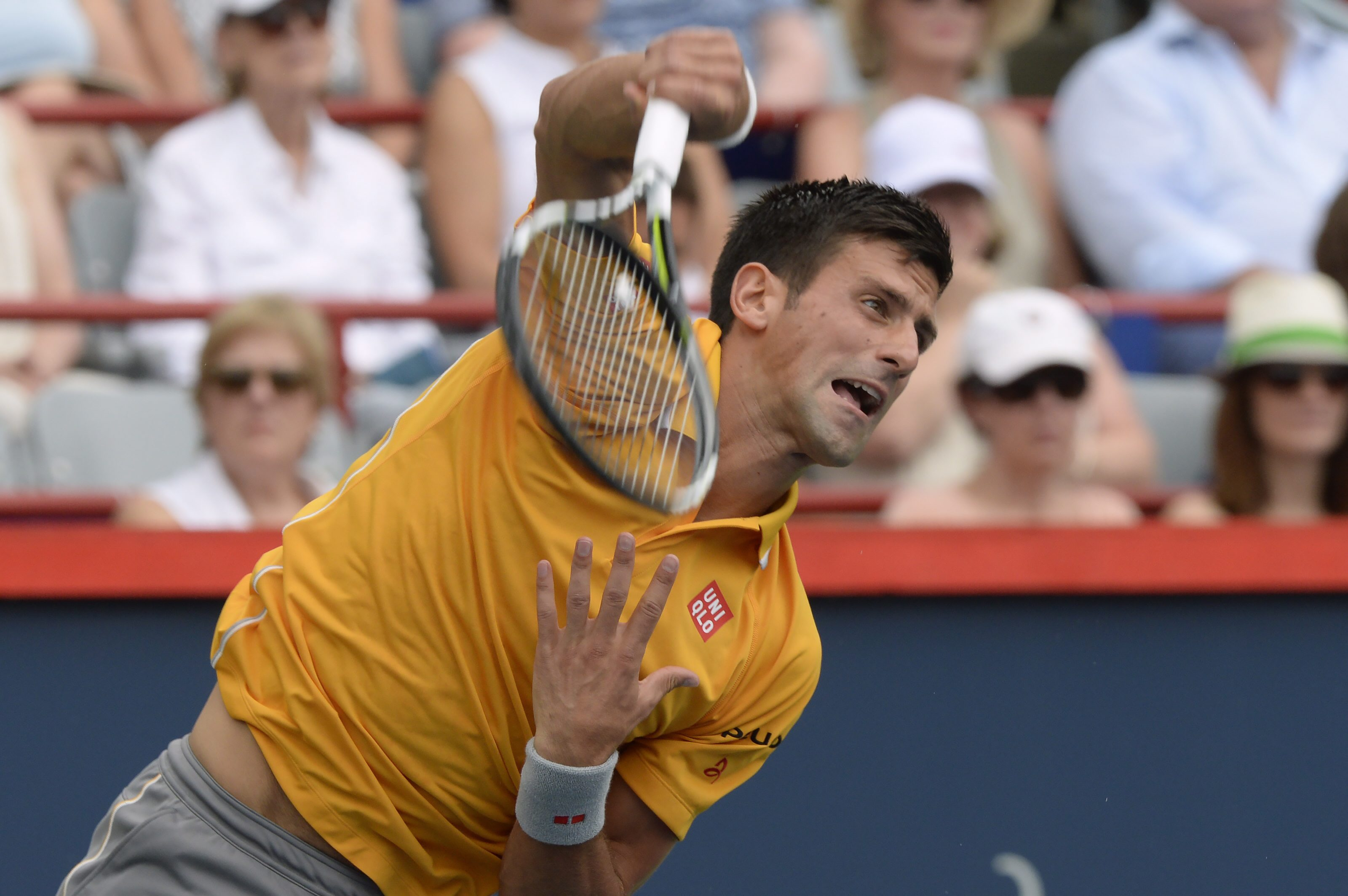 Novak Djokovic, of Serbia, serves to Jeremy Chardy, of France, during the Rogers Cup semifinal tennis tournament, Saturday, Aug. 15, 2015 in Montreal.(Paul Chiasson/The Canadian Press via AP) MANDATORY CREDIT