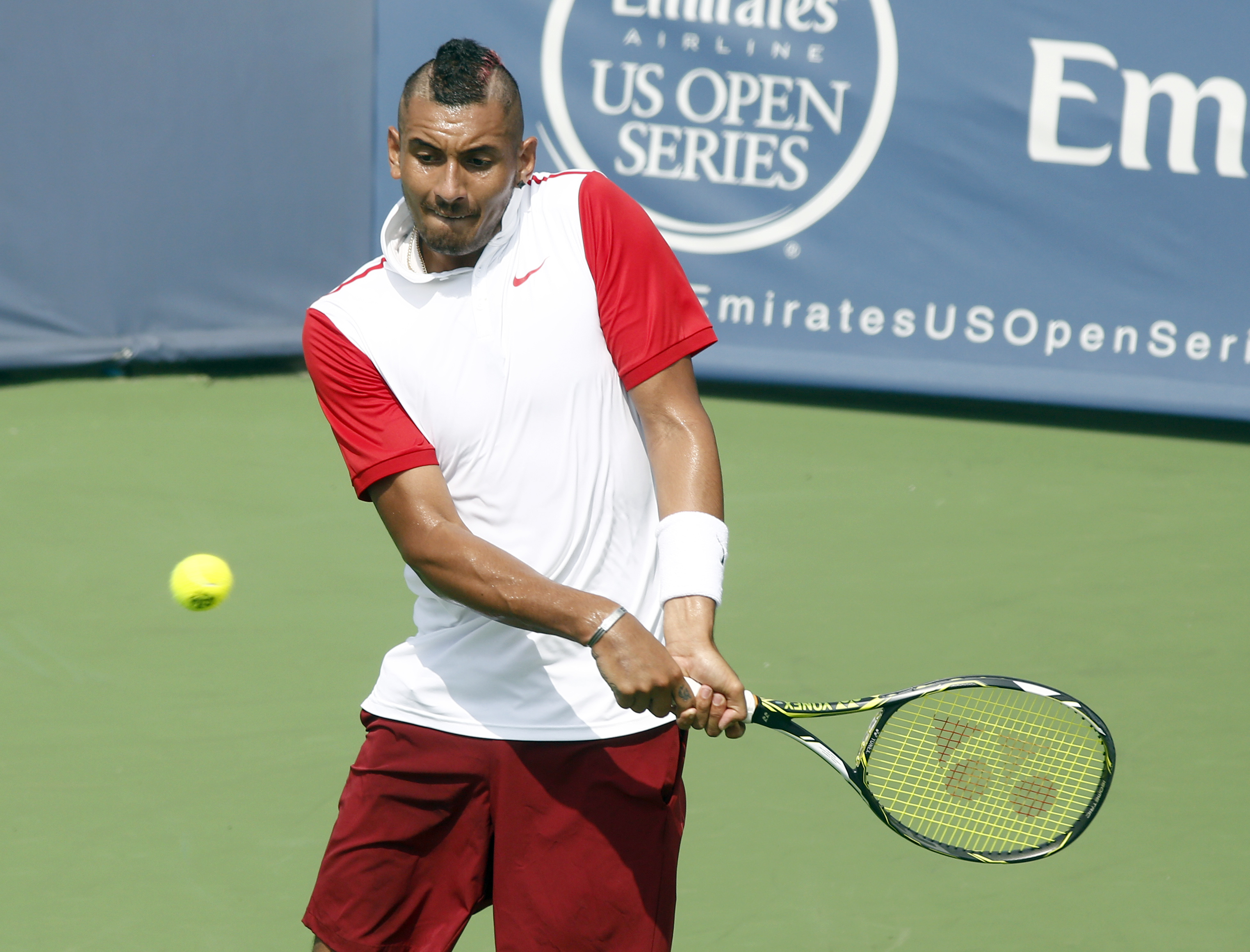 Nick Kyrgios, of Australia, returns to Richard Gasquet, of France, during a first round match at the Western & Southern Open tennis tournament, Tuesday, Aug. 18, 2015, in Mason, Ohio. (AP Photo/David Kohl)