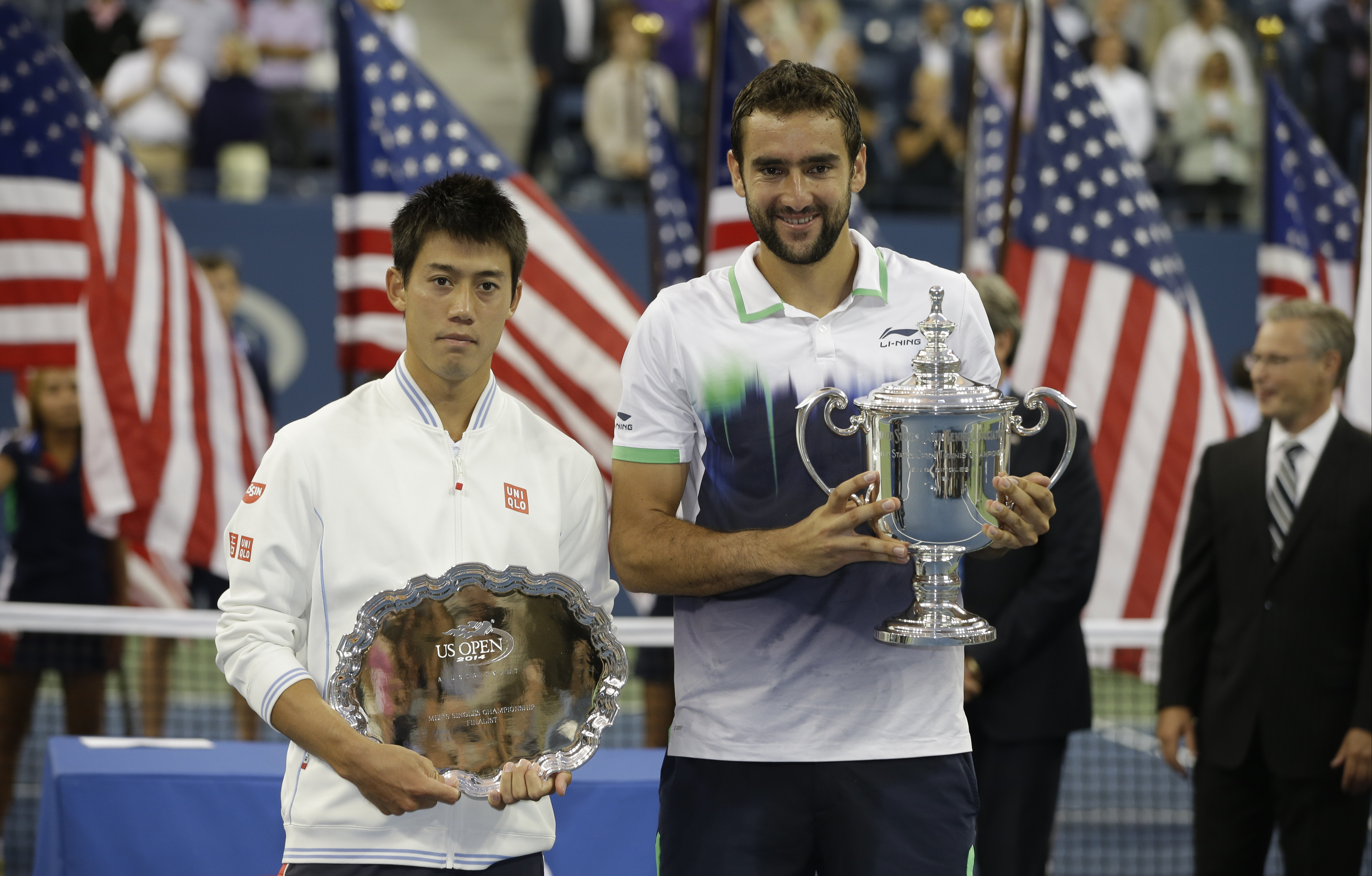 FILE - In this Sept. 8, 2014, file photo, Marin Cilic, of Croatia, right, holds the championship trophy and Kei Nishikori, of Japan, holds the runner-up trophy after Cilic defeated Nishikori in the championship match of the 2014 U.S. Open tennis tournamen