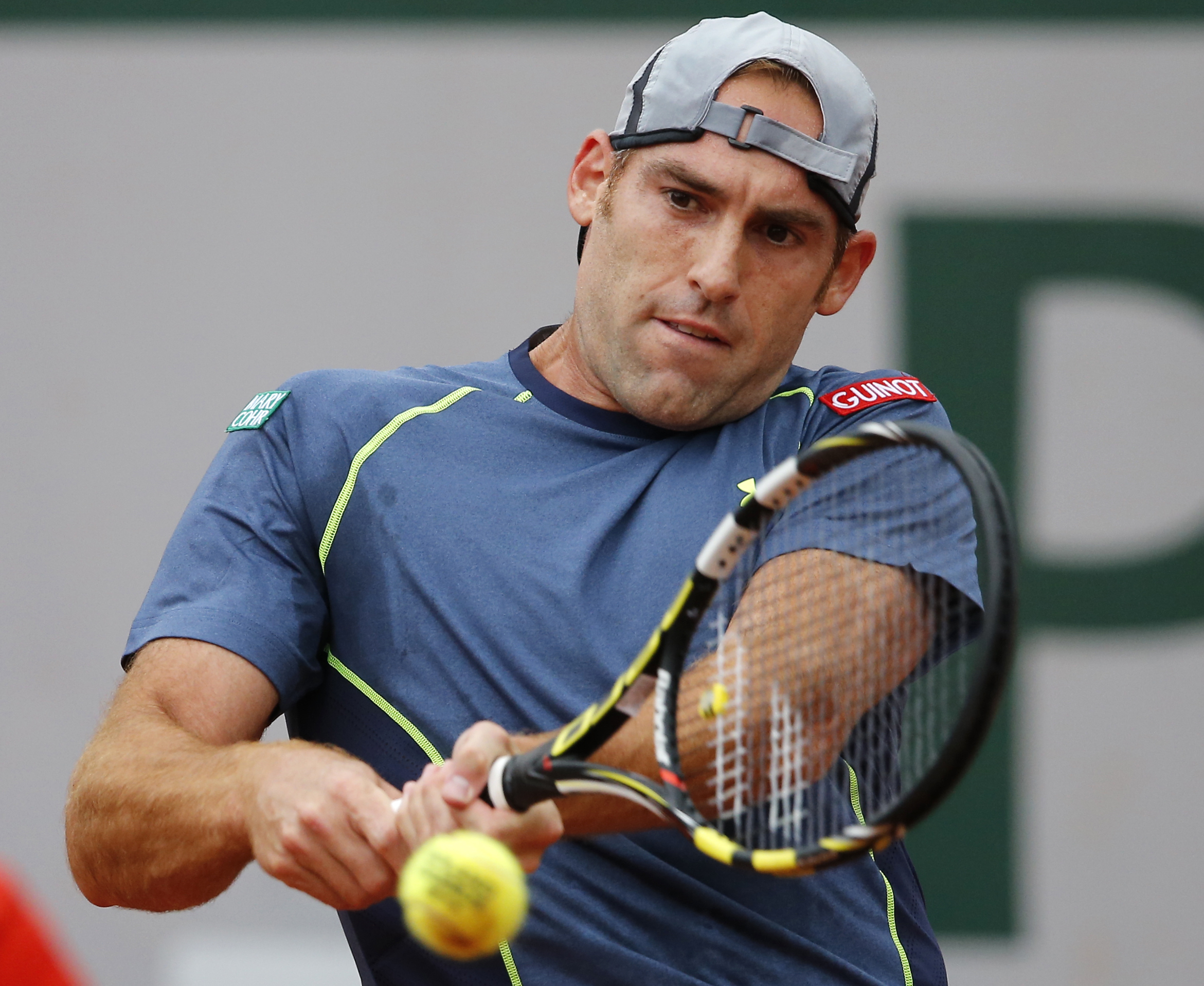 Robby Ginepri of the U.S, returns the ball to Spain's Rafael Nadal during the first round match of  the French Open tennis tournament at the Roland Garros stadium, in Paris, France, Monday, May 26, 2014. (AP Photo/Michel Spingler)