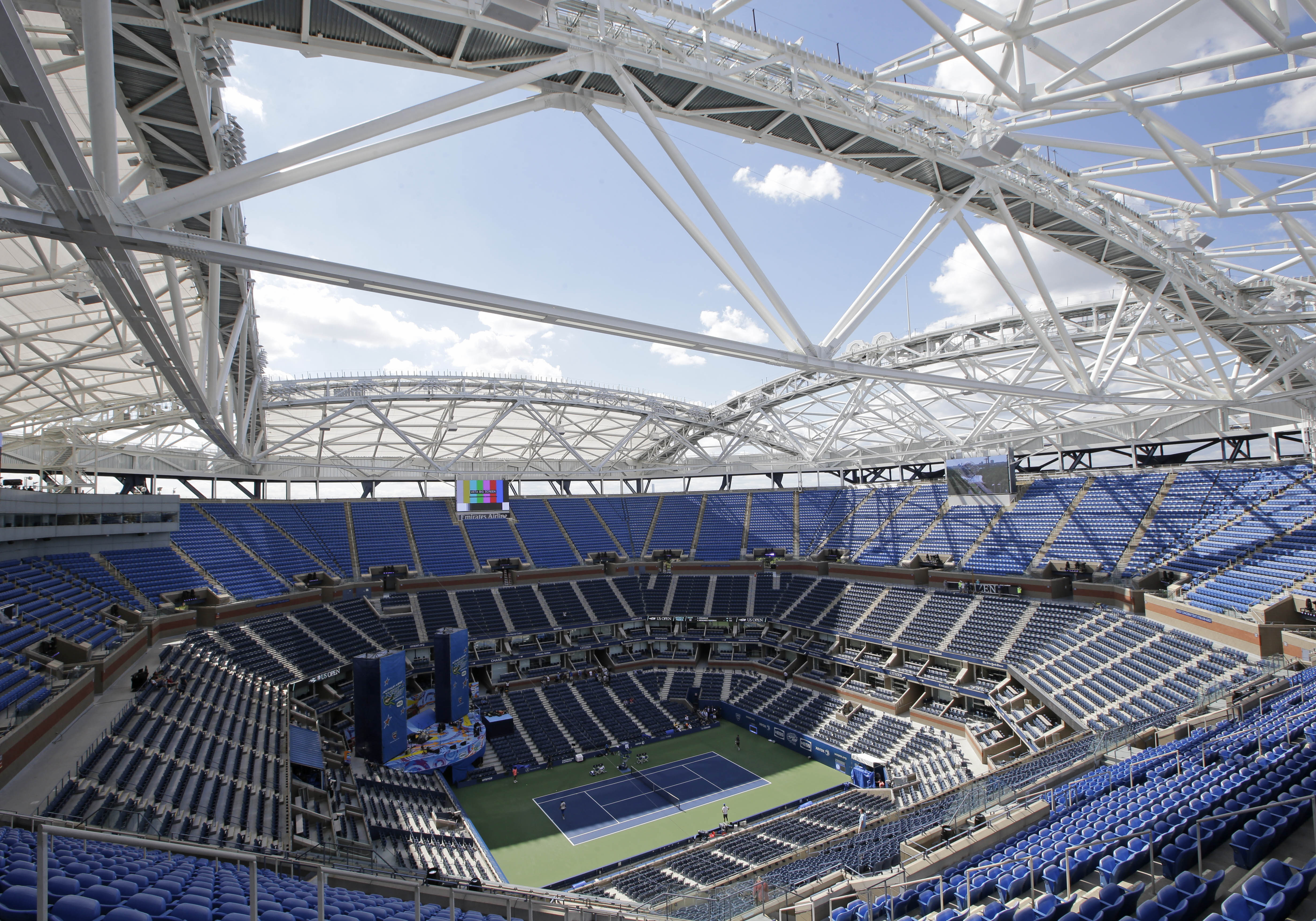 A view from the upper seating section in Arthur Ashe Stadium shows the framework of a retractable roof over the main court at the USTA Billie Jean King National Tennis Center in New York, Thursday, Aug. 27, 2015, home to the U.S. Open tennis tournament. A