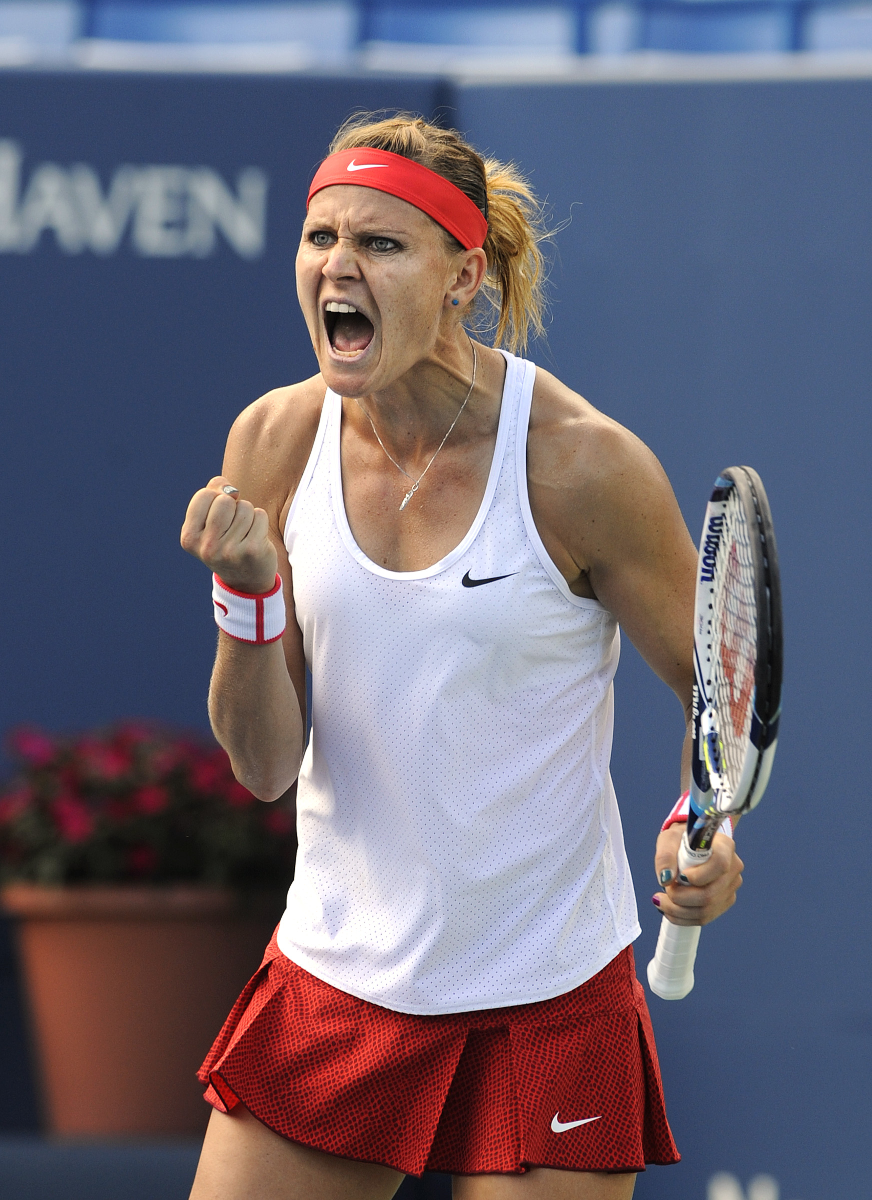 Lucie Safarova, of the Czech Republic, celebrates after her 6-2, 7-6 (4) victory over Leslie Tsurenko, of Ukraine, in their semifinal match at the Connecticut Open tennis tournament in New Haven, Conn., on Friday, Aug. 28, 2015. (AP Photo/Fred Beckham)