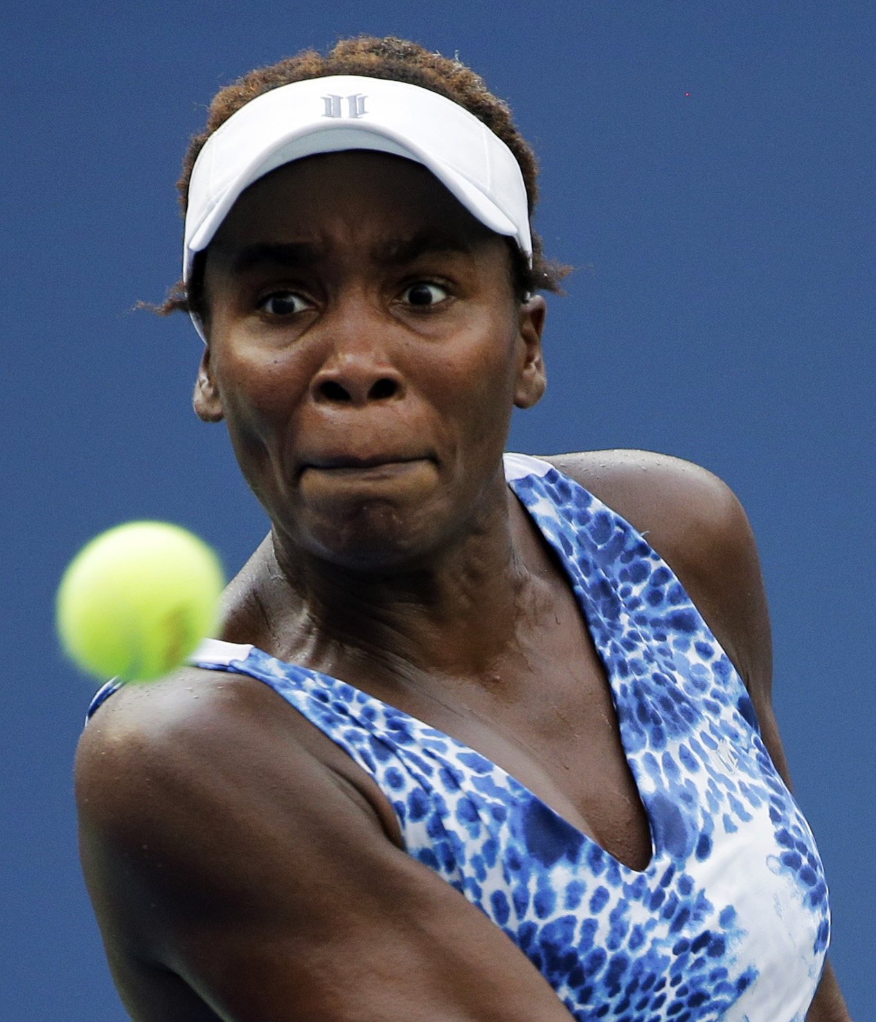 Venus Williams, of the United States, returns a shot against Monica Puig, of Puerto Rico, during the first round of the U.S. Open tennis tournament, Monday, Aug. 31, 2015, in New York. (AP Photo/Matt Rourke)