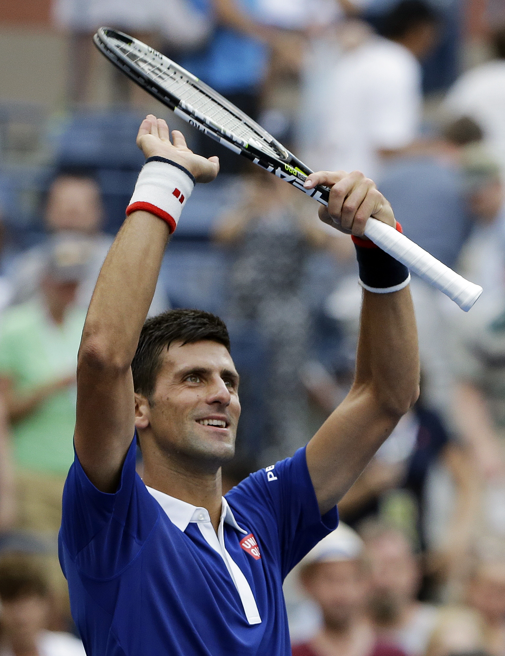 Novak Djokovic, of Serbia, reacts to the crowd after defeating Joao Souza, of Brazil, during the first round of the U.S. Open tennis tournament, Monday, Aug. 31, 2015, in New York. (AP Photo/Matt Rourke)