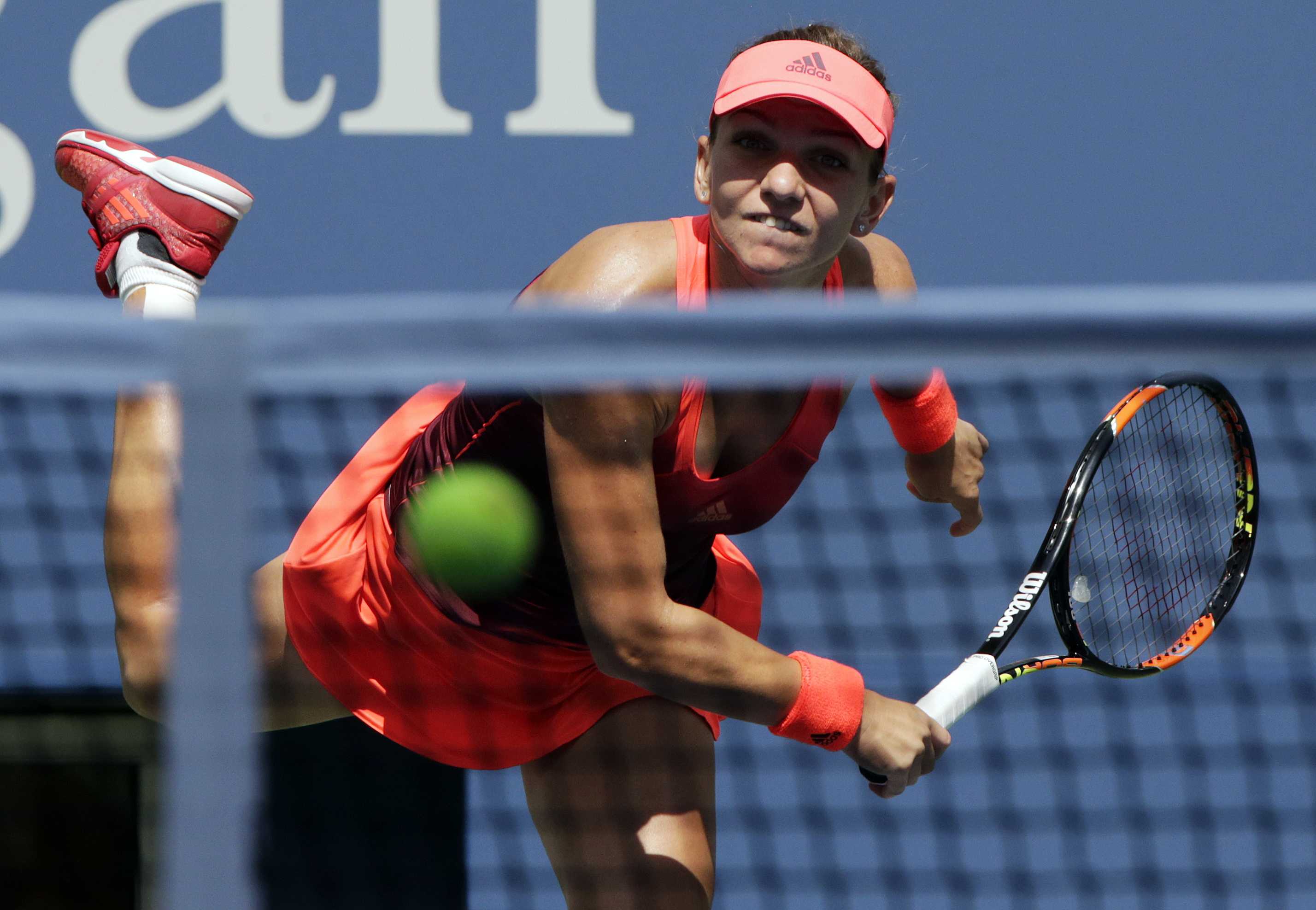Simona Halep, of Romania, serves against Marina Erakovic, of New Zealand, during the first round of the U.S. Open tennis tournament, Tuesday, Sept. 1, 2015, in New York. (AP Photo/Charles Krupa)