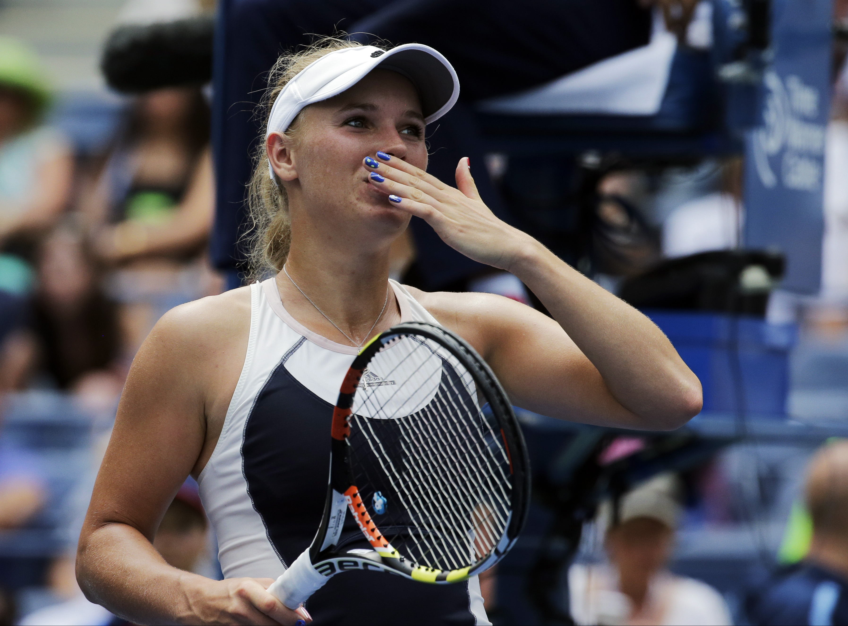Caroline Wozniacki, of Denmark, blows kisses to the crowd after beating Jamie Loeb, of the United States, during the first round of the U.S. Open tennis tournament, Tuesday, Sept. 1, 2015, in New York. (AP Photo/Charles Krupa)